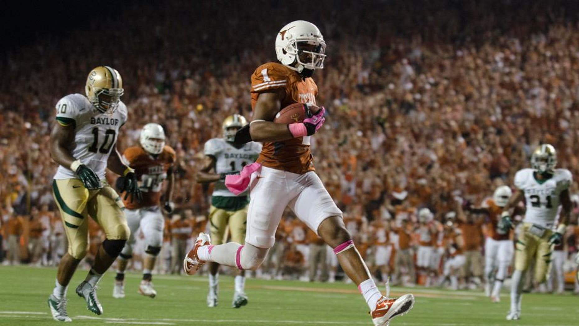 Oct 20, 2012; Austin, TX, USA; Texas Longhorns wide receiver Mike Davis (1) scores a touchdown against the Baylor Bears during the second half at Darrell K Royal-Texas Memorial Stadium. Texas beat Baylor 56-50. Mandatory Credit: Brendan Maloney-USA TODAY Sports