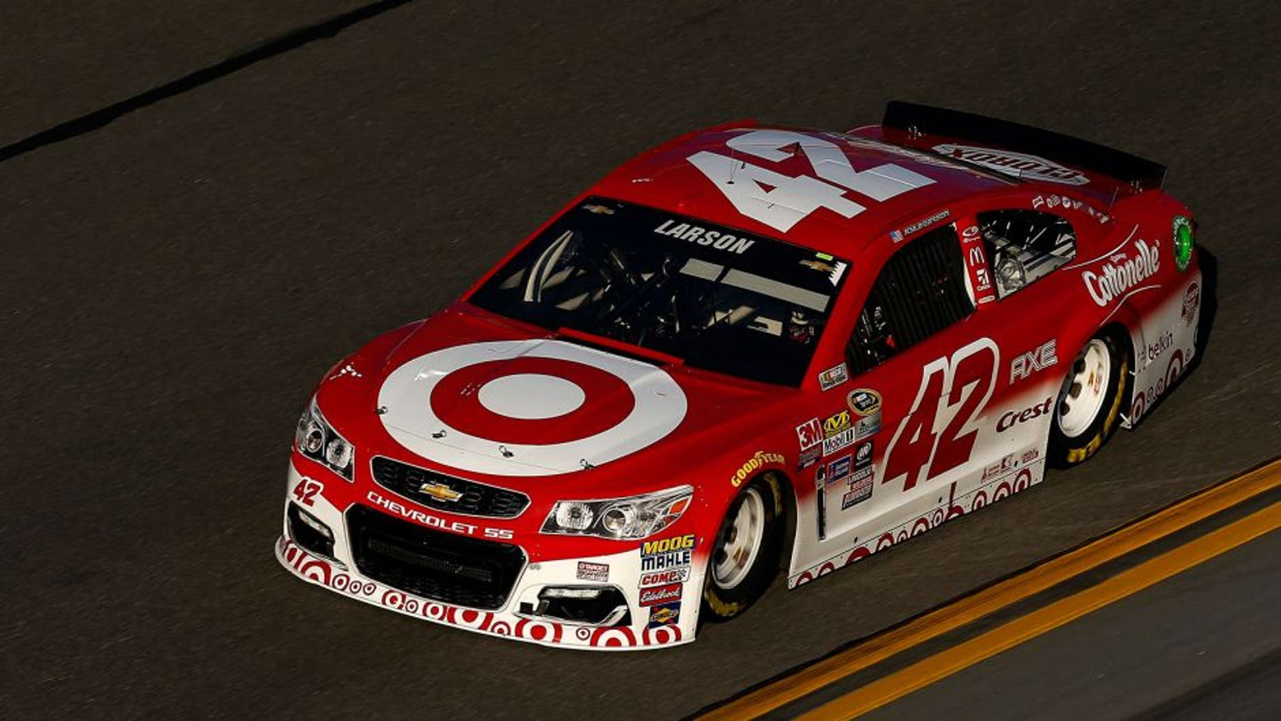 DAYTONA BEACH, FL - FEBRUARY 12: Kyle Larson, driver of the #42 Target Chevrolet, stands in the garage area during practice for the NASCAR Sprint Cup Series Sprint Unlimited at Daytona International Speedway on February 12, 2016 in Daytona Beach, Florida. (Photo by Jonathan Ferrey/NASCAR via Getty Images)