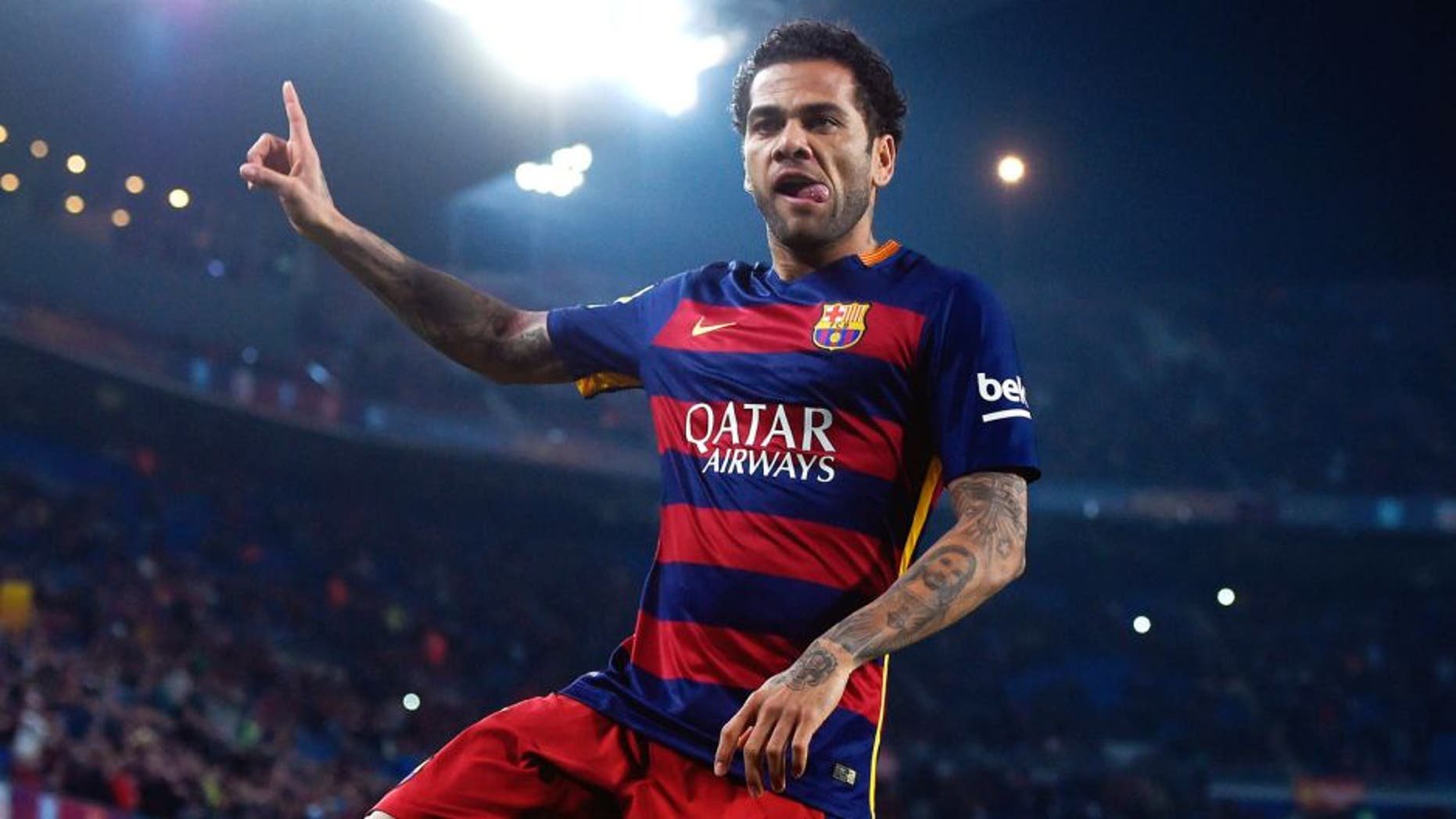 BARCELONA, SPAIN - DECEMBER 02: Dani Alves of FC Barcelona celebrates after scoring the opening goal during the Copa del Rey Round of 32 second leg match betwen FC Barcelona and Villanovense on December 2, 2015 in Barcelona, Spain. (Photo by David Ramos/Getty Images)