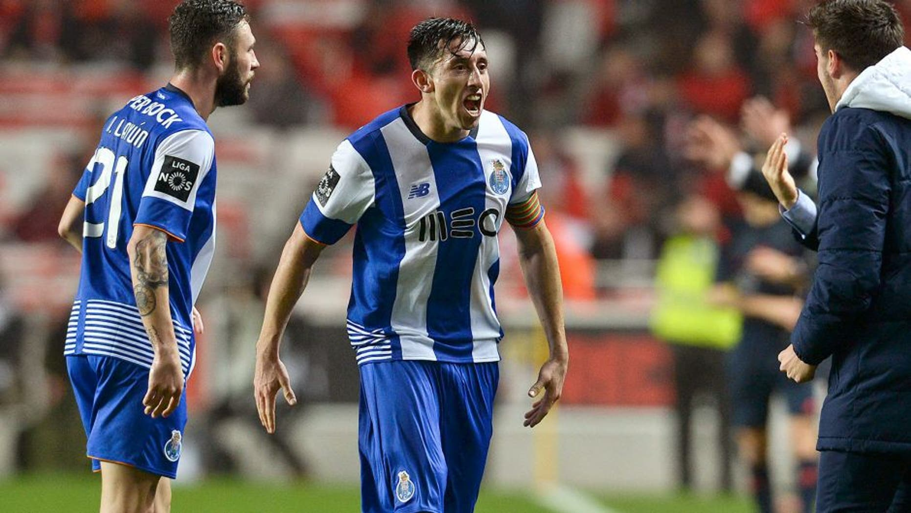 Porto's Mexican midfielder Hector Herrera (2nd L) celebrates a goal with teammate Porto's Mexican defender Miguel Layun (L) during the Portuguese league football match SL Benfica vs FC Porto at the Luz stadium in Lisbon on February 12, 2016. / AFP / PATRICIA DE MELO MOREIRA (Photo credit should read PATRICIA DE MELO MOREIRA/AFP/Getty Images)