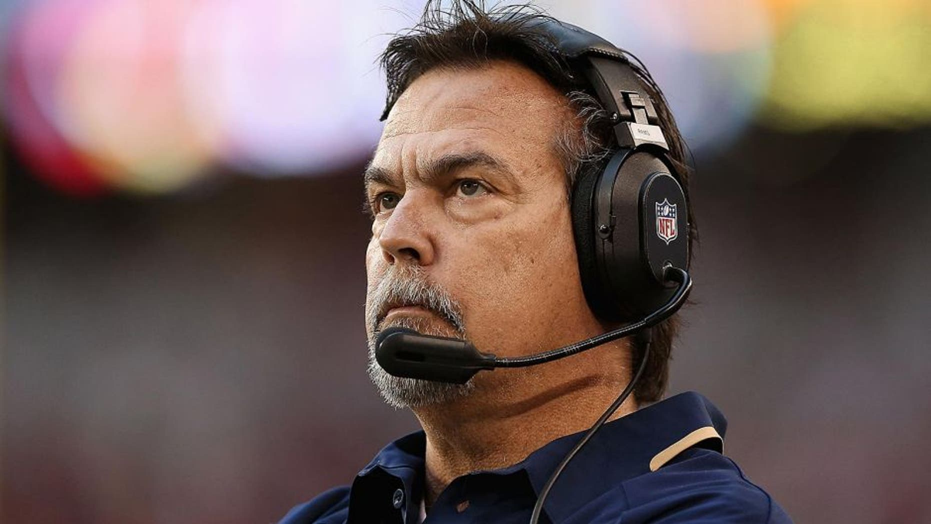 GLENDALE, AZ - DECEMBER 08: Head coach Jeff Fisher of the St. Louis Rams reacts on the sidelines during the NFL game against the Arizona Cardinals at the University of Phoenix Stadium on December 8, 2013 in Glendale, Arizona. (Photo by Christian Petersen/Getty Images)