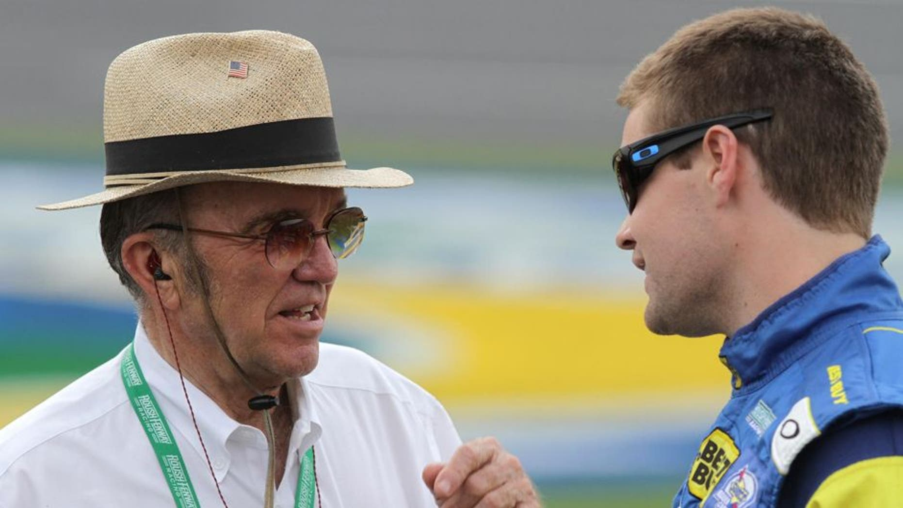 CONCORD, NC - MAY 17: Ricky Stenhouse Jr., driver of the #17 Best Buy Ford, talks to team owner Jack Roush on the grid during qualifying for the NASCAR Sprint Cup Series Showdown at Charlotte Motor Speedway on May 17, 2013 in Concord, North Carolina. (Photo by Jerry Markland/Getty Images)