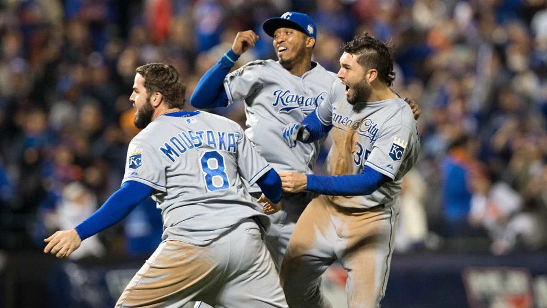 NEW YORK, NY - NOVEMBER 1: Mike Moustakas #8, Eric Hosmer #35 and Alcides Escobar #2 of the Kansas City Royals celebrate on the field after defeating the New York Mets in Game 5 of the 2015 World Series at Citi Field on Sunday, November 1, 2015 in the Queens borough of New York City. (Photo by Rob Tringali/MLB Photos via Getty Images)
