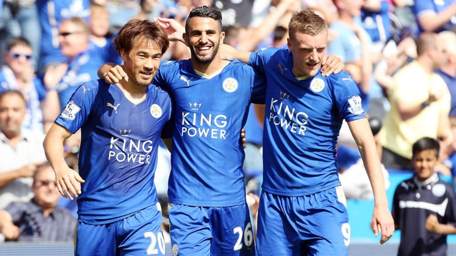 LEICESTER, ENGLAND - AUGUST 08: GOAL Riyad Mahrez of Leicester City celebrates with Jamie Vardy and Shinji Okazaki of Leicester City after scoring to make it 2-0 during the Barclays Premier League match between Leicester City and Sunderland at the King Power Stadium on August 08, 2015 in Leicester, England. (Photo by Plumb Images/Leicester City FC via Getty Images)