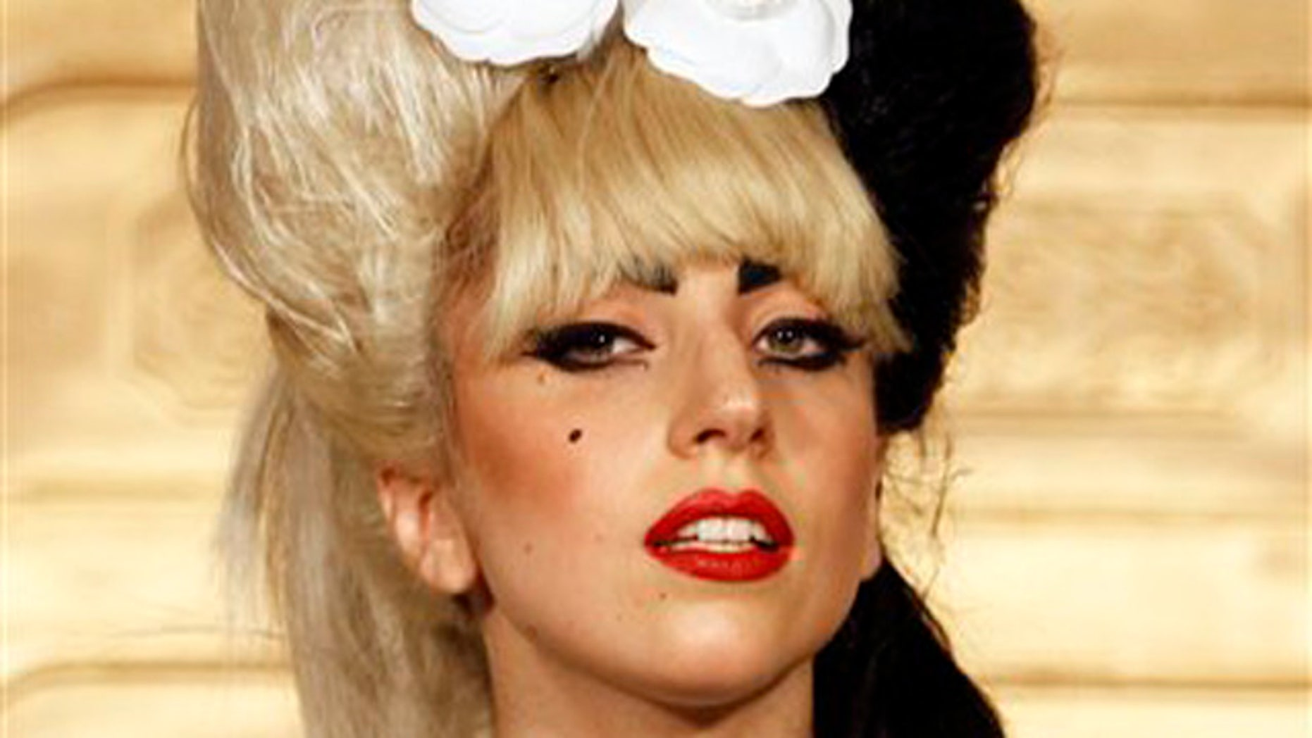 """In this July 4, 2011 file photo, singer Lady Gaga attends a news conference in Taipei, Taiwan to promote her new album """"Born This Way""""."""