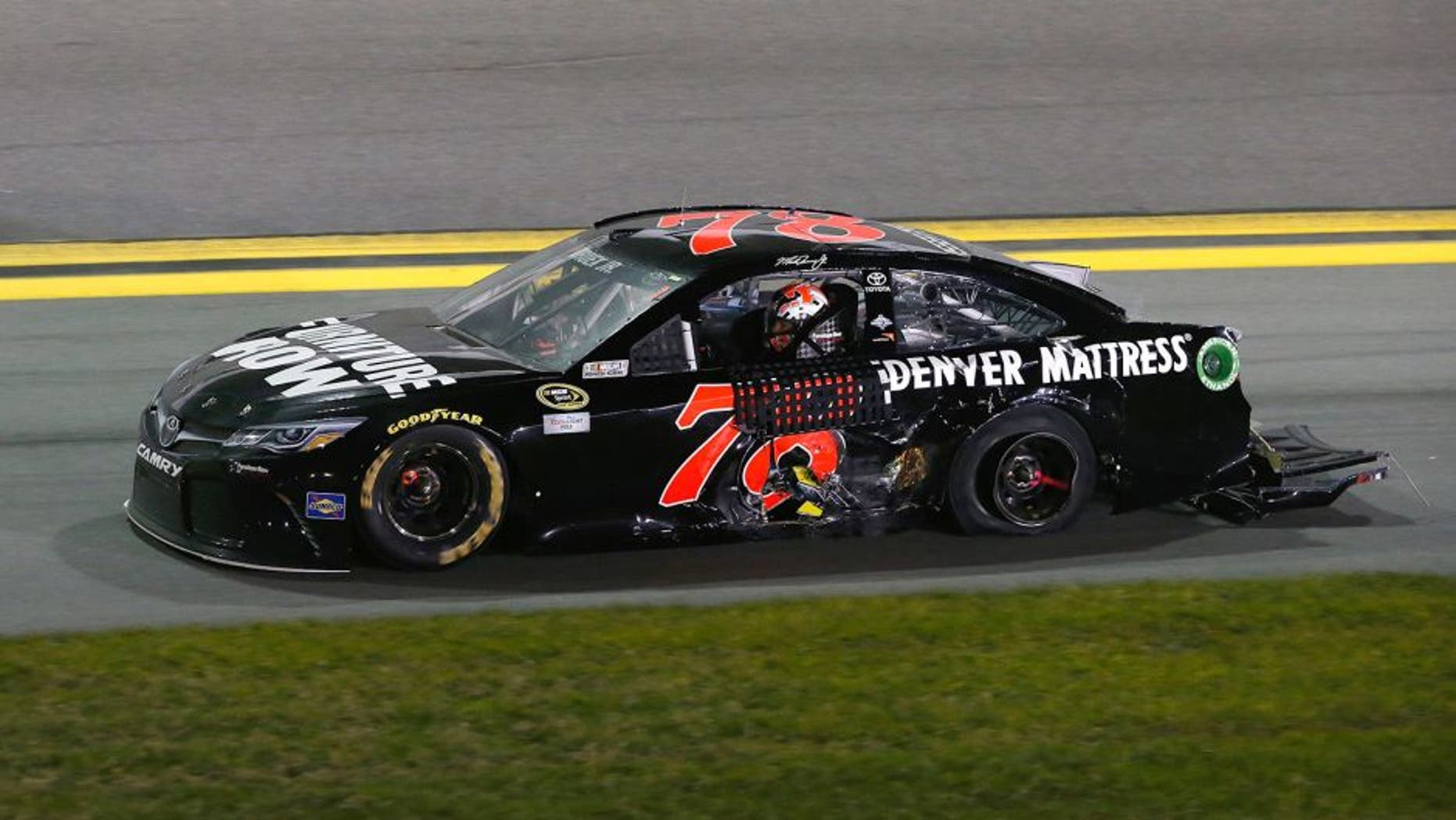 DAYTONA BEACH, FL - FEBRUARY 13: Martin Truex Jr., driver of the #78 Furniture Row/Denver Mattress Toyota, drives his car after being involved in an on-track incident during the NASCAR Sprint Cup Series Sprint Unlimited at Daytona International Speedway on February 13, 2016 in Daytona Beach, Florida. (Photo by Brian Lawdermilk/Getty Images)