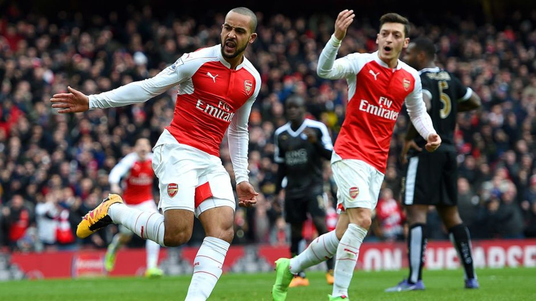 LONDON, ENGLAND - FEBRUARY 14: Theo Walcott of Arsenal celebrates after scoring his team's first goal during the Barclays Premier League match between Arsenal and Leicester City at Emirates Stadium on February 14, 2016 in London, England. (Photo by Ross Kinnaird/Getty Images)