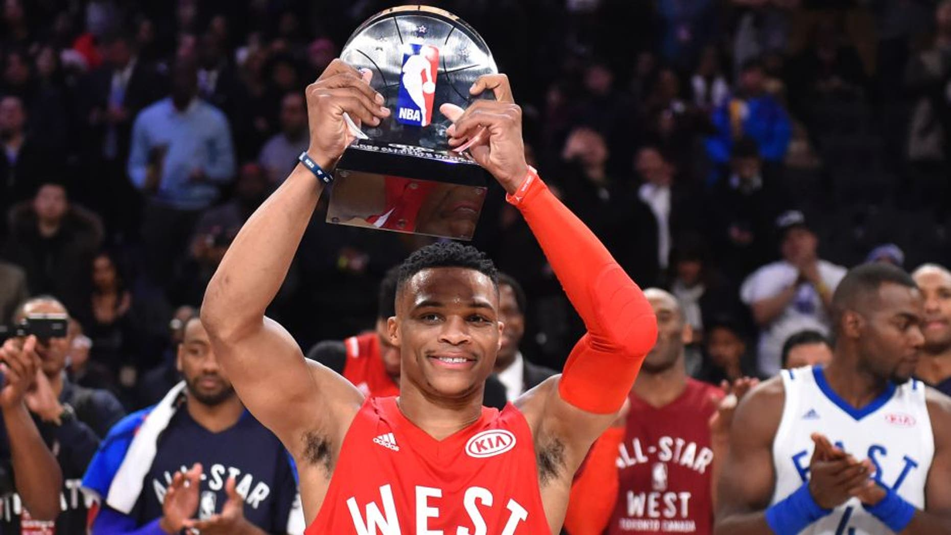 Feb 14, 2016; Toronto, Ontario, CAN; Western Conference guard Russell Westbrook of the Oklahoma City Thunder (0) celebrates after being named MVP of the NBA All Star Game at Air Canada Centre. Mandatory Credit: Bob Donnan-USA TODAY Sports