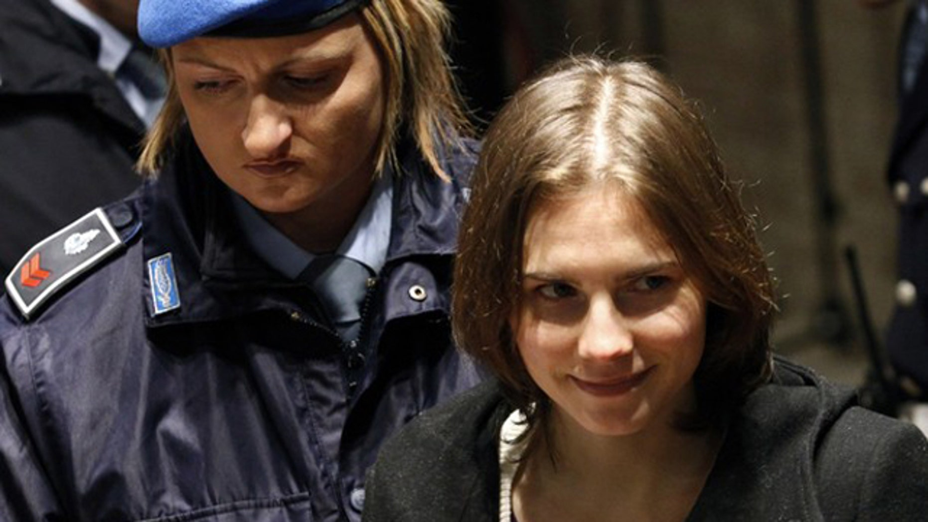 Jan. 22: Amanda Knox, the U.S. student convicted of killing her British flatmate in Italy in 2007, arrives back in court after a break during a trial session in Perugia.