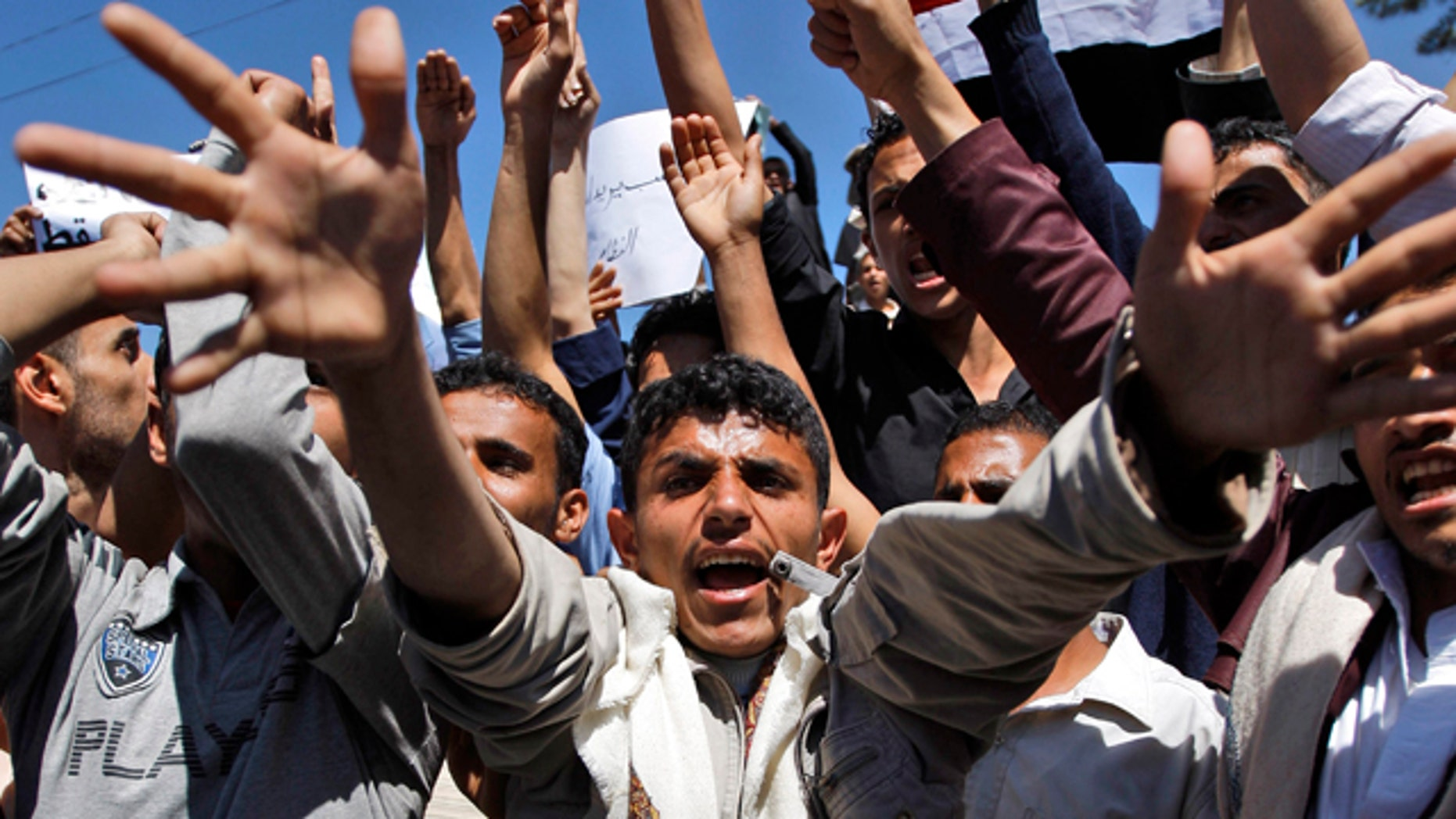 Feb. 14: Yemeni anti-government protestors shout slogans during a demonstration demanding political reform and the resignation of President Ali Abdullah Saleh in Sanaa, Yemen.