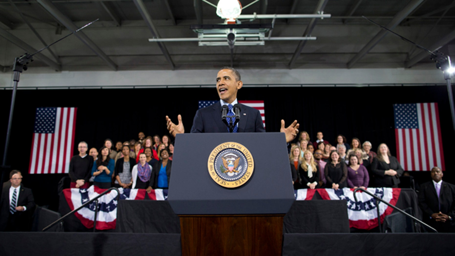 President Barack Obama gestures as he speaks about education, Thursday, Feb. 14, 2013, at the Decatur Community Recreation Center in Decatur, Ga.  The president is traveling to promote his economic and educational plan that he highlighted in his State of the Union address. (AP Photo/ Evan Vucci)