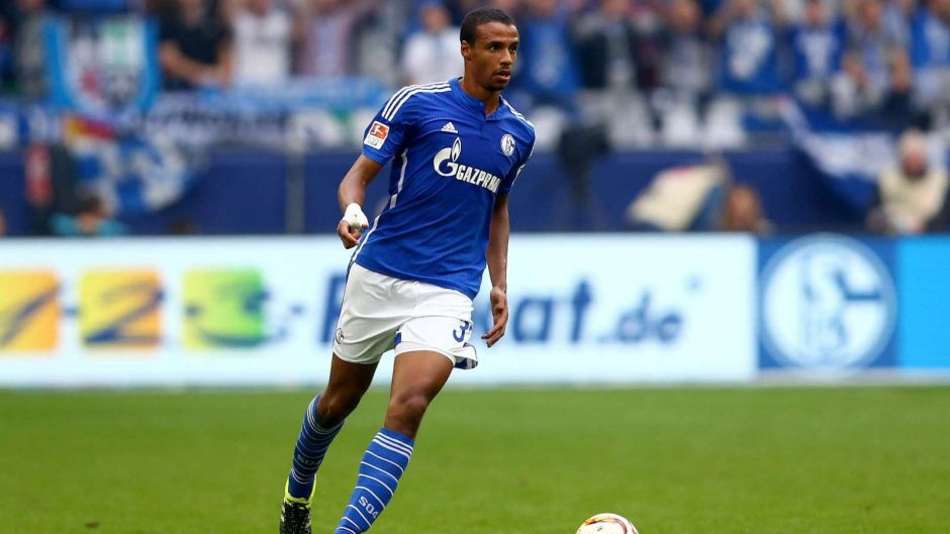 GELSENKIRCHEN, GERMANY - OCTOBER 04: Joel Matip of Schalke runs with the ball during the Bundesliga match between FC Schalke 04 and 1. FC Koeln at Veltins-Arena on October 4, 2015 in Gelsenkirchen, Germany. (Photo by Christof Koepsel/Bongarts/Getty Images)