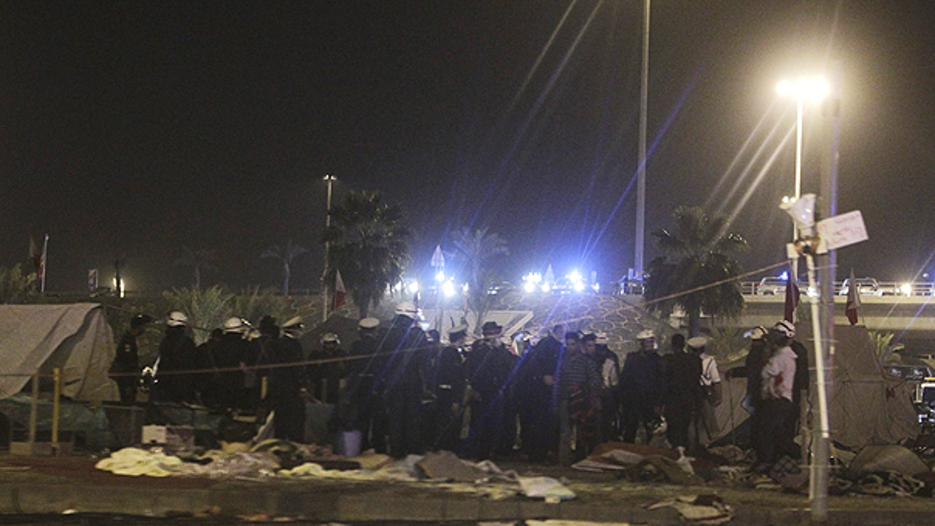 Feb. 17: Bahrani riot policemen are seen after attacking peaceful demonstrators camping at the Pearl roundabout, in Manama, Bahrain.