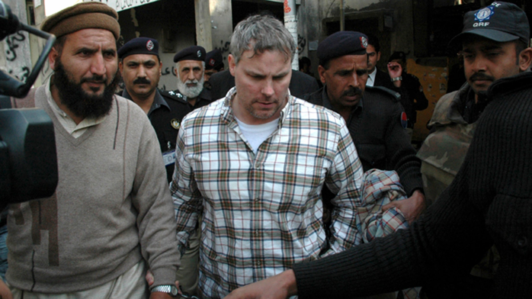 Jan. 28: Pakistani security officials escort Raymond A. Davis, a U.S. consulate employee, to a local court in Lahore, Pakistan.