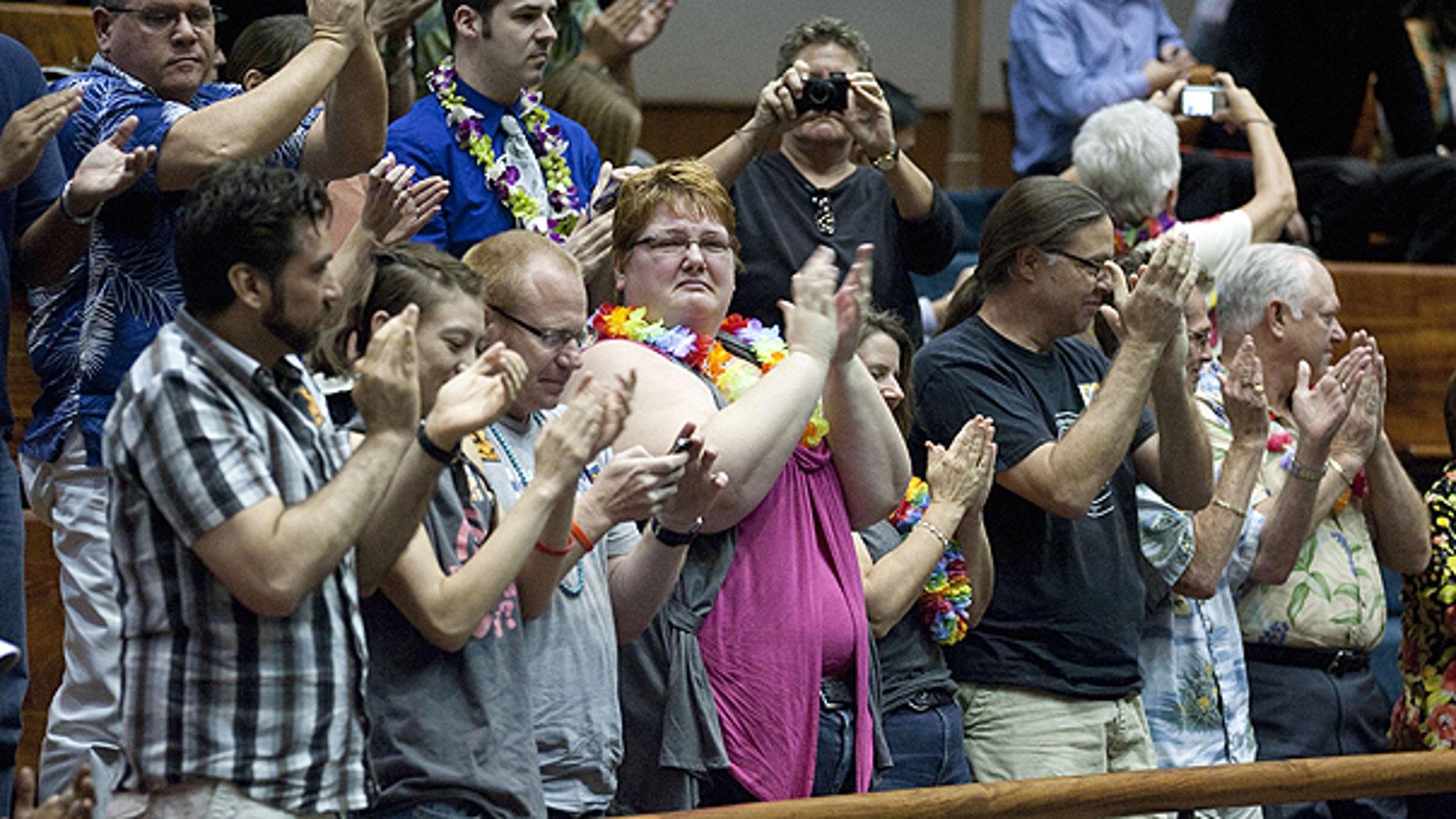 Feb. 16: Supports of the Hawaii Civil Unions Bill applaud, celebrating the Hawaii Senate's vote 18-5 to approve the Civil Unions bill at the State Capitol in Honolulu, Hawaii.