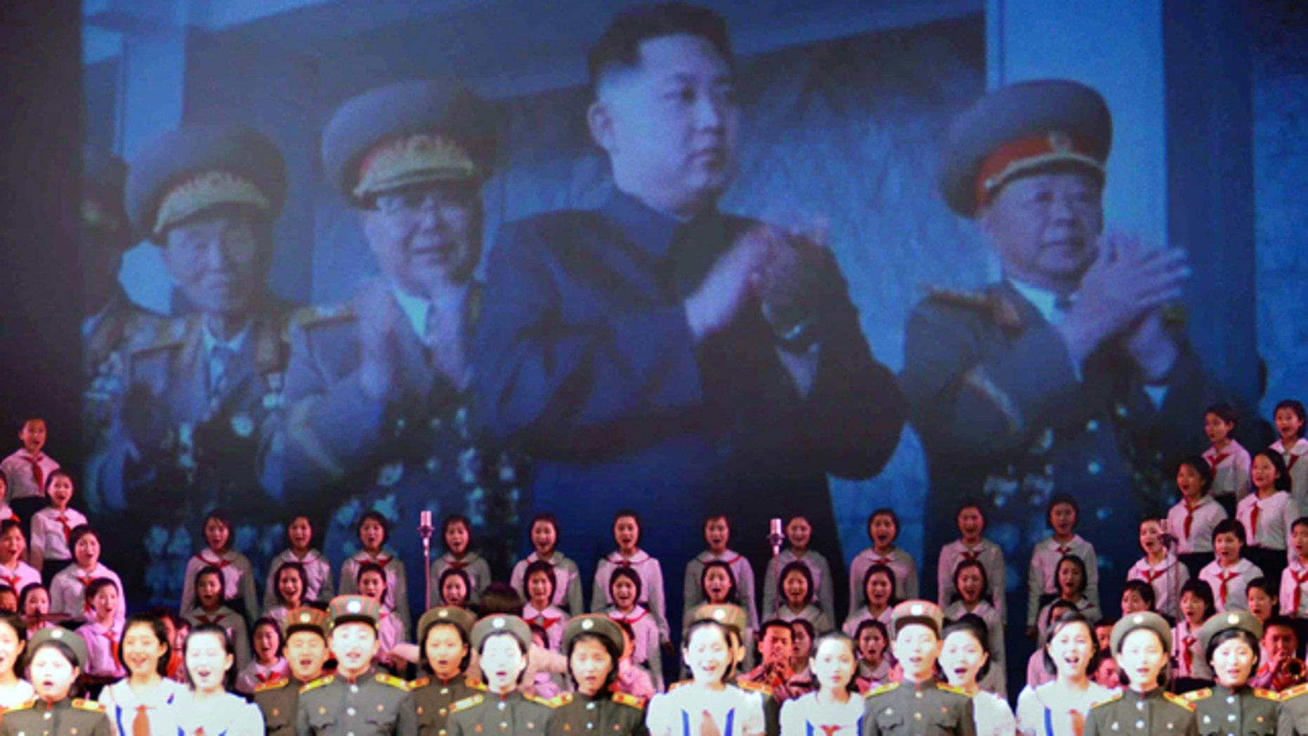 Feb. 16: An image of North Korea's heir apparent Kim Jong Un, center, is shown on the screen during a performance to celebrate the 69th birthday of their leader, Kim Jong Il, in the North Korean capital of Pyongyang.