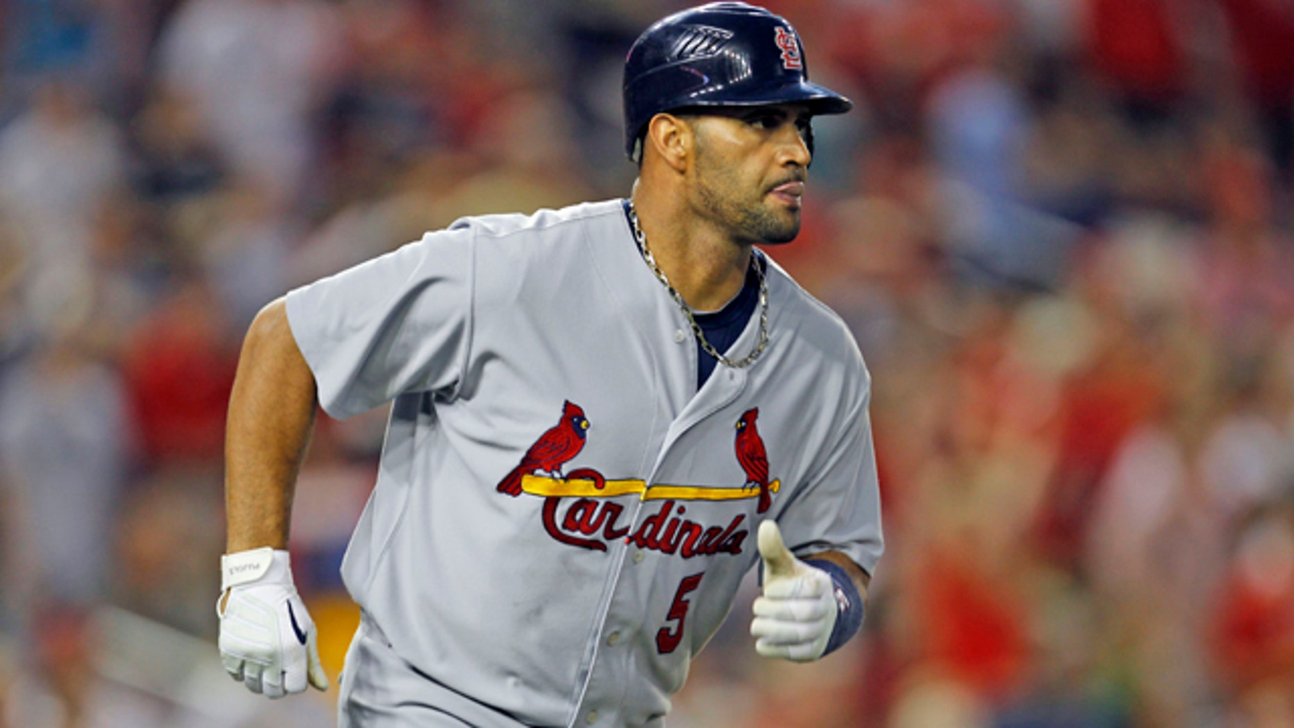 This Aug. 26, 2010, file photo shows St. Louis Cardinals' Albert Pujols running the bases after his 400th home run.