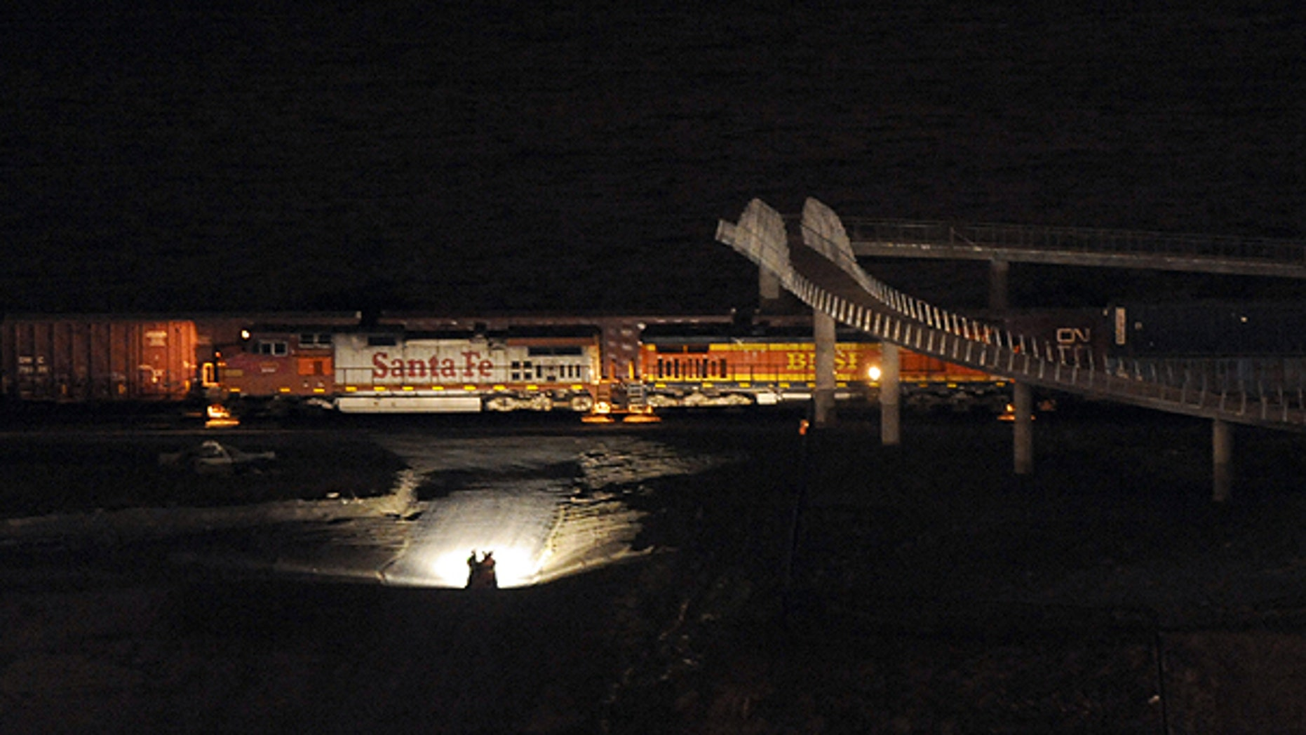 Feb. 26: ights from a truck illuminate train cars near Chambers Bay in University Place, Wash., after two trains collided.