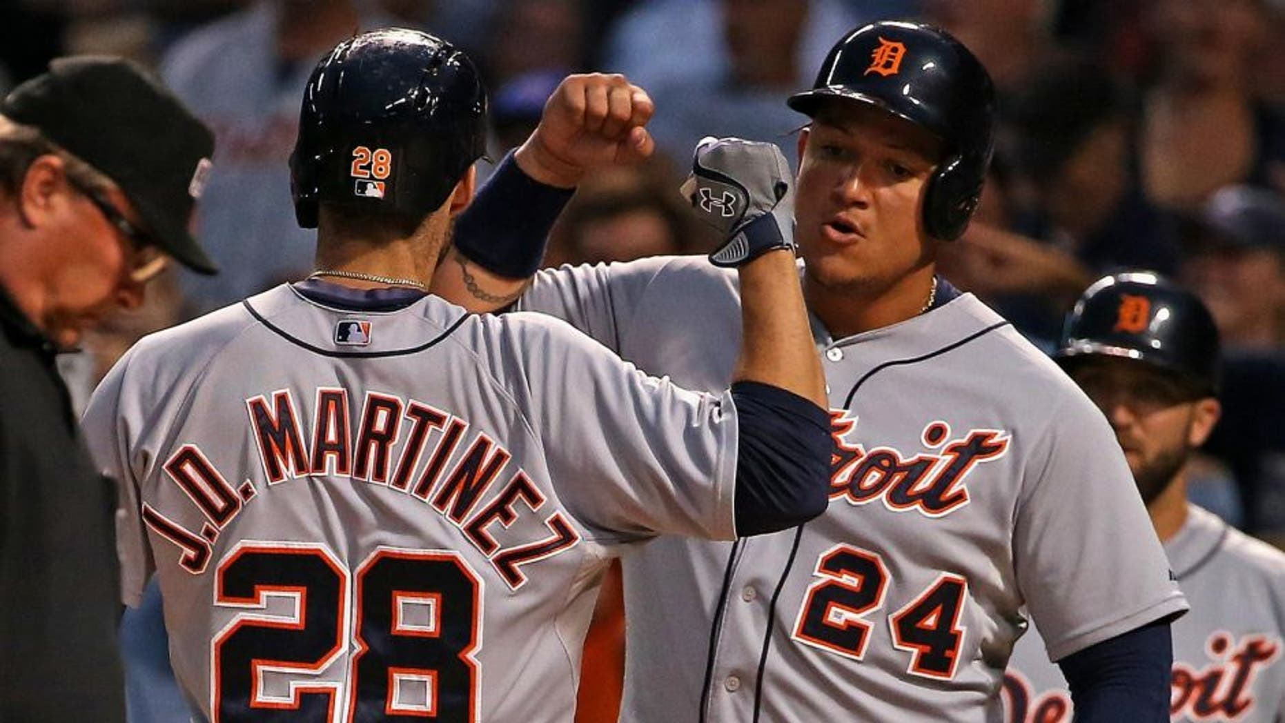CHICAGO, IL - AUGUST 18: J.D. Martinez #28 of the Detroit Tigers is greeted by Miguel Cabrera #24 after he hit a two-run home run in the 1st inning against the Chicago Cubs at Wrigley Field on August 18, 2015 in Chicago, Illinois. (Photo by Jonathan Daniel/Getty Images)