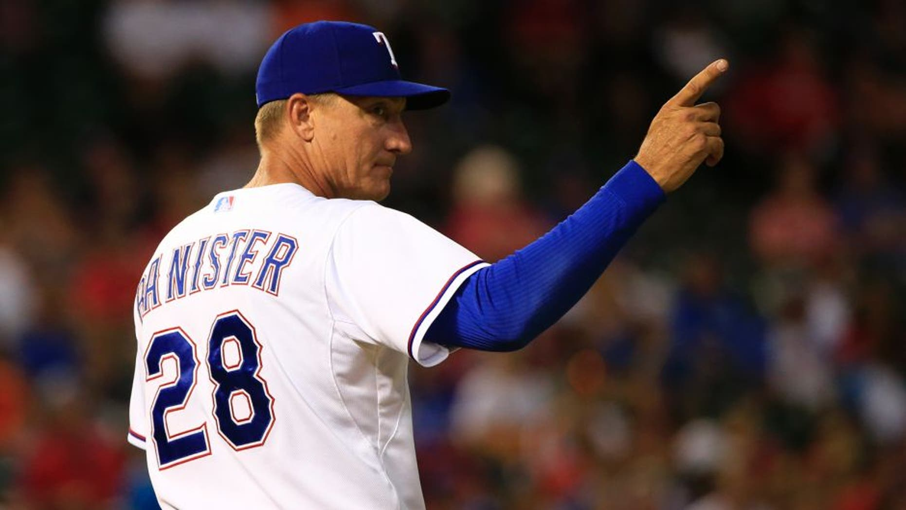 Aug 3, 2015; Arlington, TX, USA; Texas Rangers manager Jeff Banister (28) makes a pitching change during the game against the Houston Astros at Globe Life Park in Arlington. Mandatory Credit: Kevin Jairaj-USA TODAY Sports
