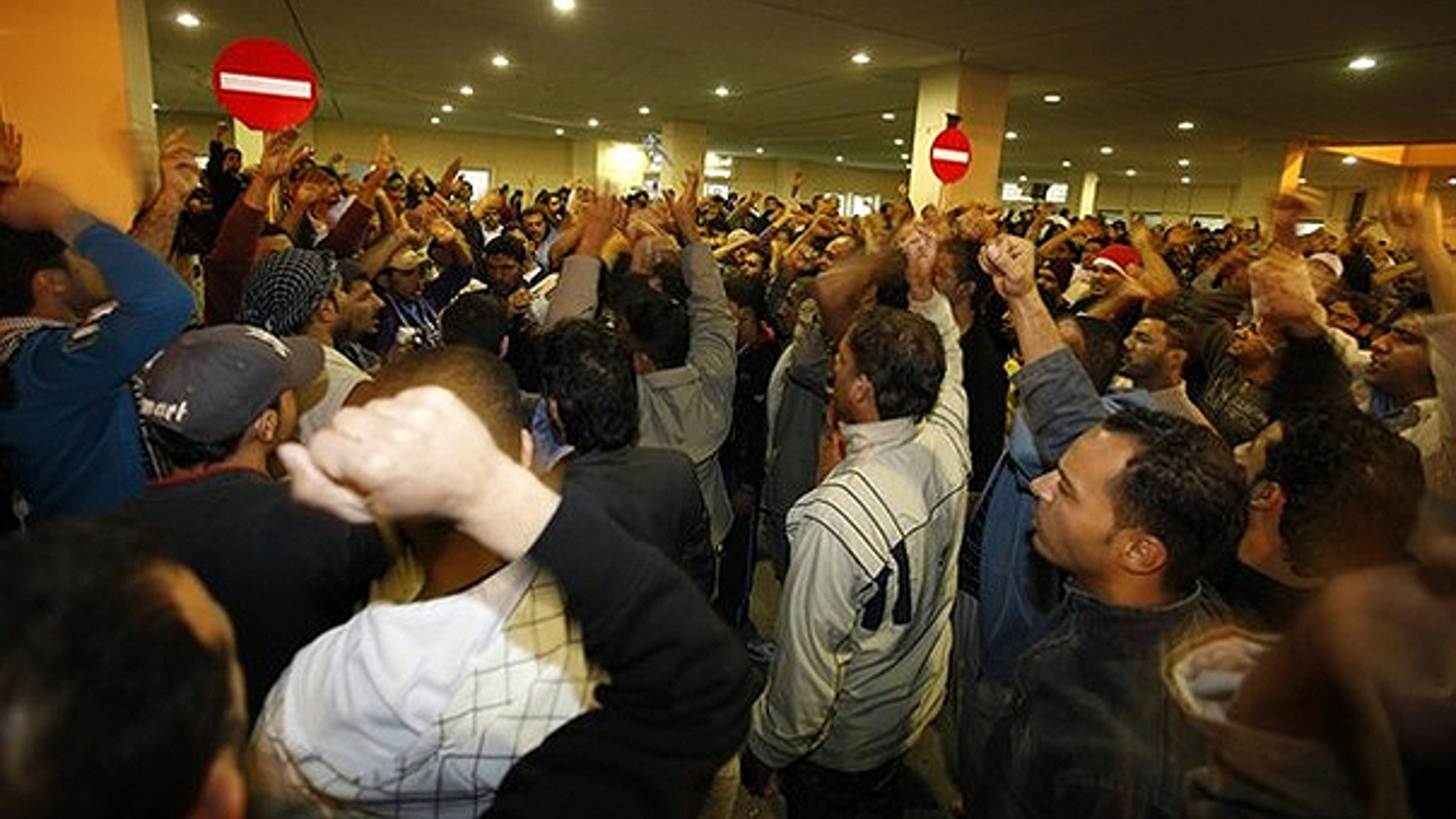 Feb. 17: People gather to mourn and protest for demonstrators who were injured after riot police stormed an anti-government protest camp, outside the Salmaniya hospital where the casualties were sent to, in Manama.