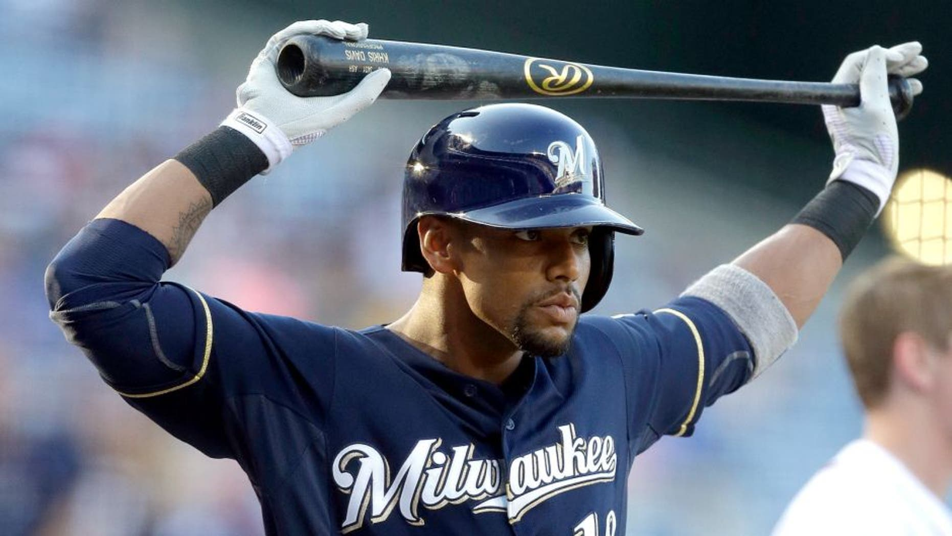 ATLANTA GA - MAY 22: Khris Davis #18 of the Milwaukee Brewers stretches in the batter's box during the first inning of a baseball game on May 22, 2015 at Turner Field in Atlanta, Georgia. (Photo by Butch Dill/Getty Images)