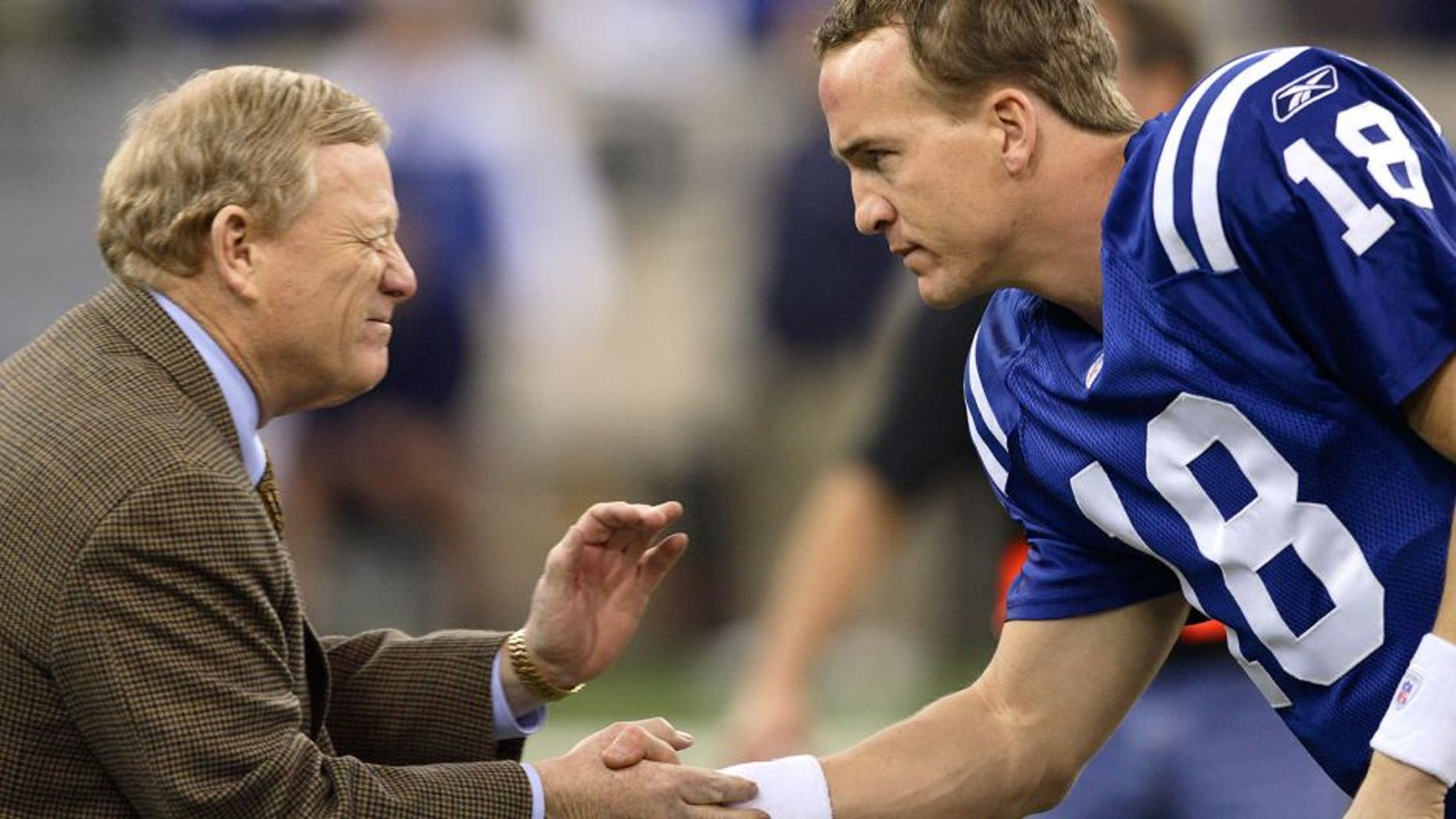 INDIANAPOLIS - JANUARY 21: Peyton Manning #18 of the Indianapolis Colts is greeted by Bill Polian the team's president before the AFC Championship game against the New England Patriots at the RCA Dome on January 21, 2007 in Indianapolis, Indiana. The Colts defeated the Patriots 38-34. (Photo by Joe Robbins/Getty Images)