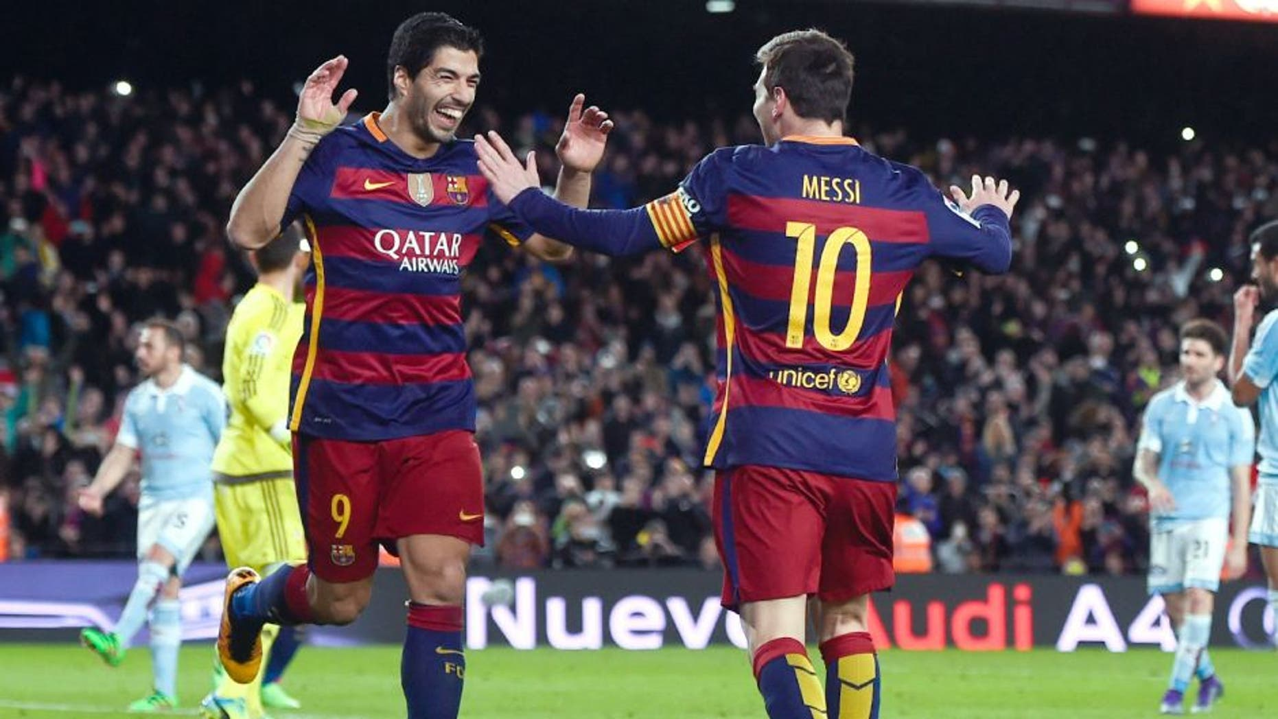 BARCELONA, SPAIN - FEBRUARY 14: (L-R) Luis Suarez of FC Barcelona celebrates with his team mate Lionel Messi of FC Barcelona after scoring his team's fourth goal from the penalty spot during the La Liga match between FC Barcelona and Celta Vigo at Camp Nou on February 14, 2016 in Barcelona, Spain. (Photo by David Ramos/Getty Images)