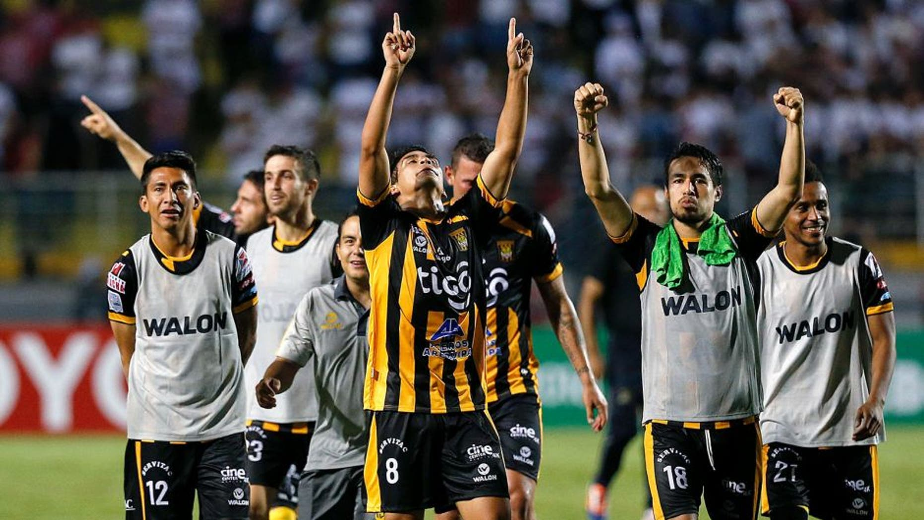 Players of Bolivia's The Strongest celebrate winning their Copa Libertadores soccer match against Brazil's Sao Paulo FC in Sao Paulo, Brazil, Wednesday, Feb. 17, 2016. (AP Photo/Andre Penner)