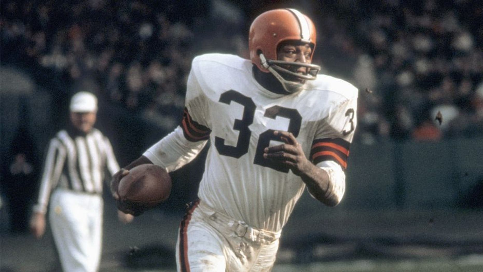 CLEVELAND, OH - 1960: Runningback Jim Brown #32 of the Cleveland Browns runs with the ball during a game in the 1960's at Municipal Stadium in Cleveland, Ohio. (Photo by: Tony Tomsic/Getty Images)