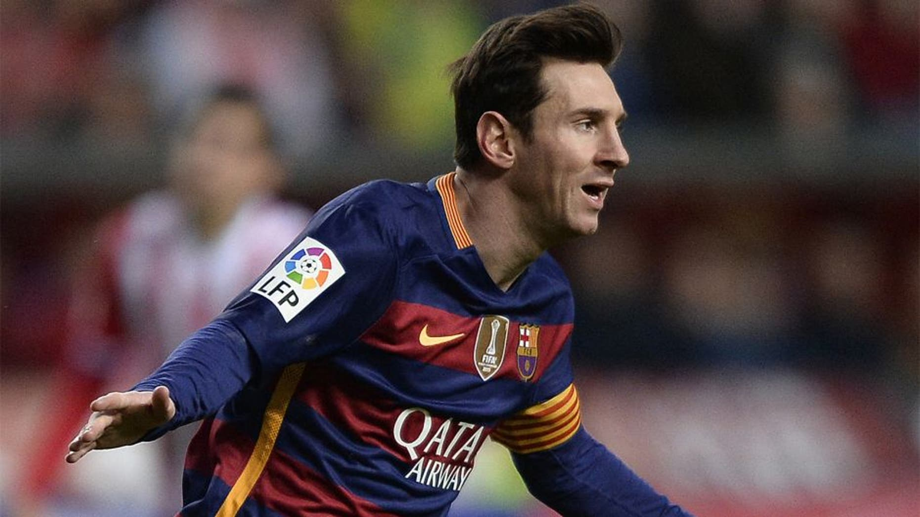 Barcelona's Argentinian forward Lionel Messi celebrates after scoring a goal during the Spanish league football match Real Sporting de Gijon vs FC Barcelona at El Molinon stadium in Gijonon 2016. AFP PHOTO / MIGUEL RIOPA / AFP / MIGUEL RIOPA (Photo credit should read MIGUEL RIOPA/AFP/Getty Images)