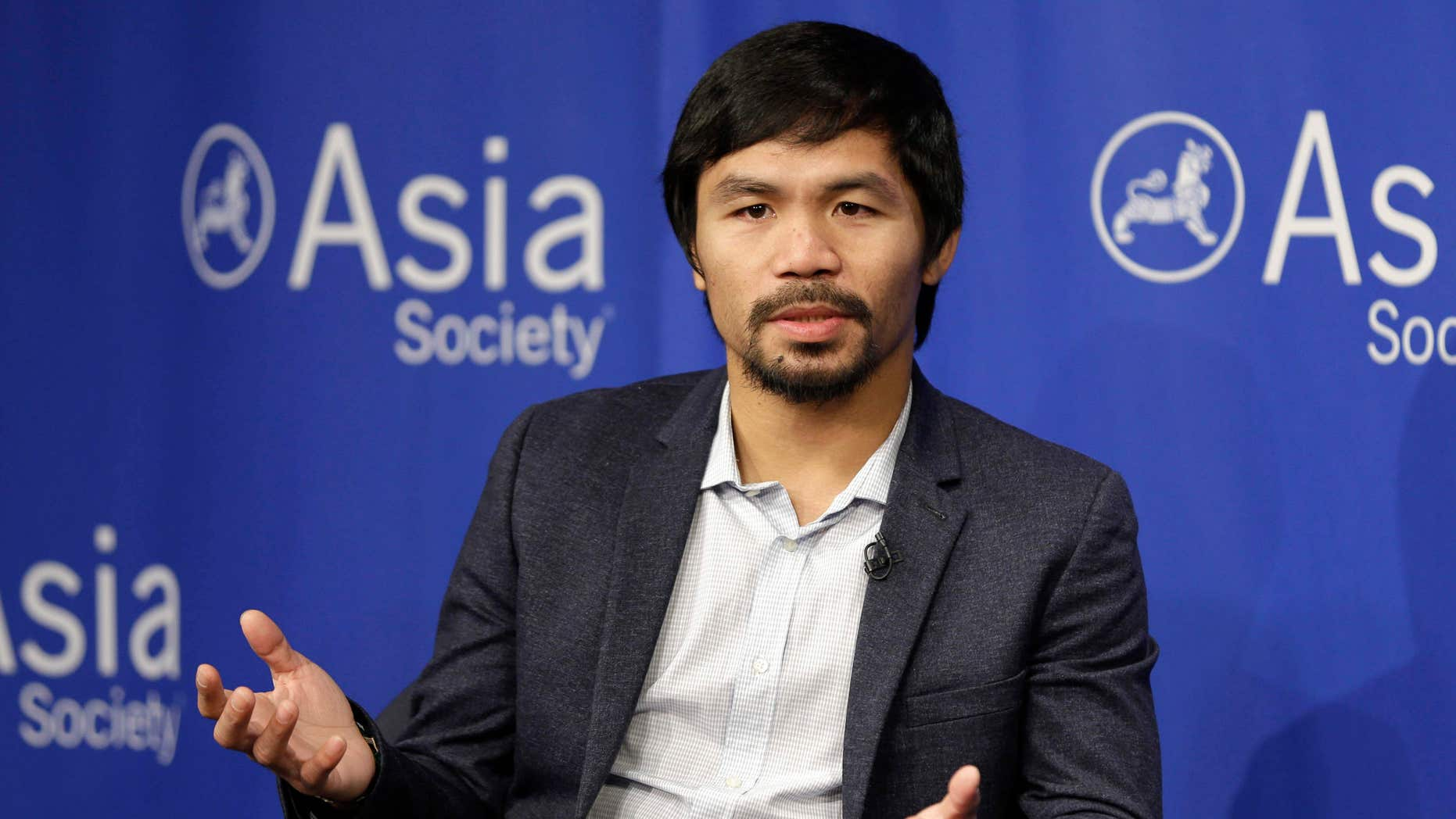 FILE - In this Oct. 12, 2015, file photo, Manny Pacquiao takes questions at the Asia Society in New York.
