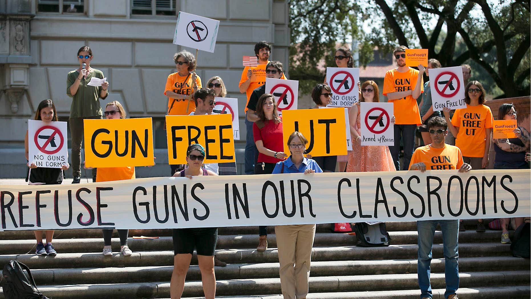 FILE - In this Oct. 1, 2015, file photo, protesters gather on the West Mall of the University of Texas campus to oppose a new state law that expands the rights of concealed handgun license holders to carry their weapons on public college campuses.