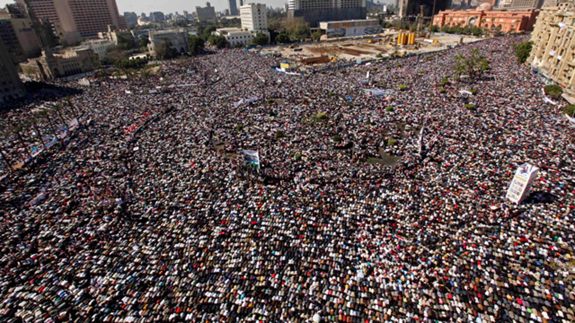 Feb. 18: Thousands pray during Friday prayers at Tahrir square in Cairo, Egypt.