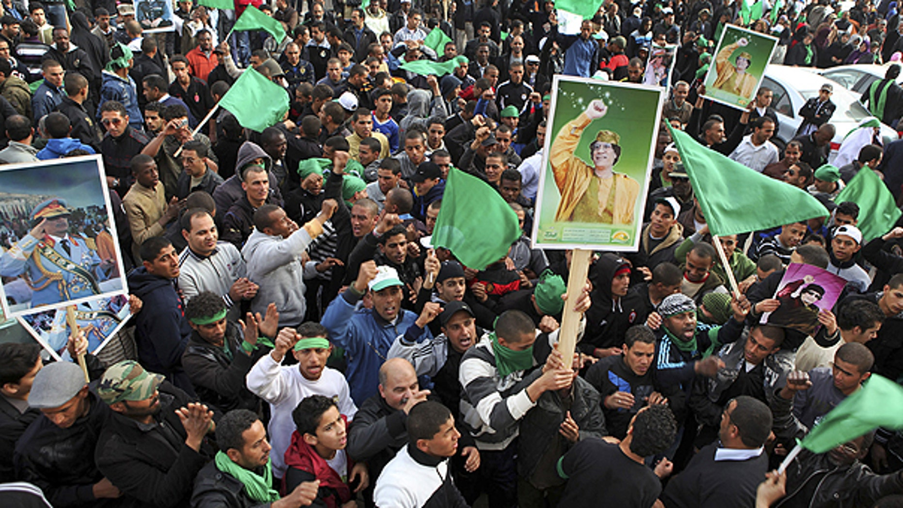 Feb. 18: Pro-Qaddafi supporters gather in Green Square after traditional Friday prayers in Tripoli, Libya.