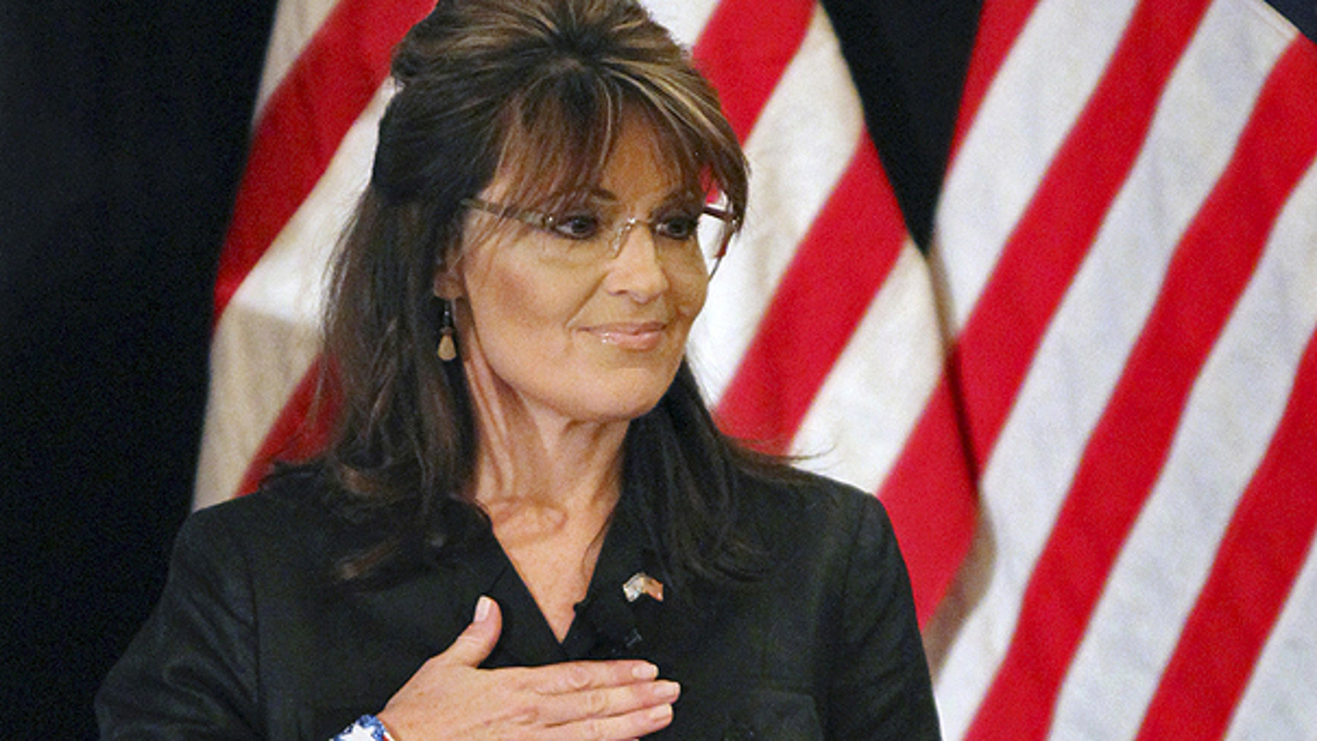 Feb. 17: Former Alaska Gov. Sarah Palin covers her heart during the national anthem as she attends a public appearance at a Long Island Association (LIA) meeting and luncheon in Woodbury, N.Y.