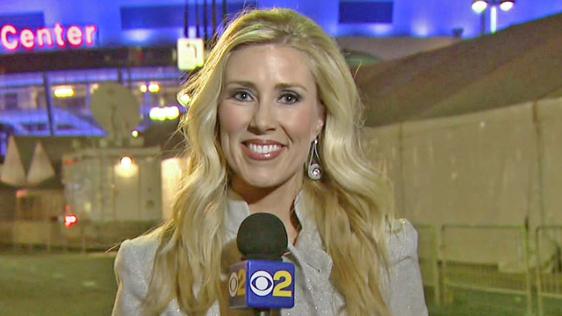 In this Feb. 13 handout file photo provided by KCBS in Los Angeles, veteran TV journalist Serene Branson reports on the Grammy awards show outside the Staples Center in Los Angeles.