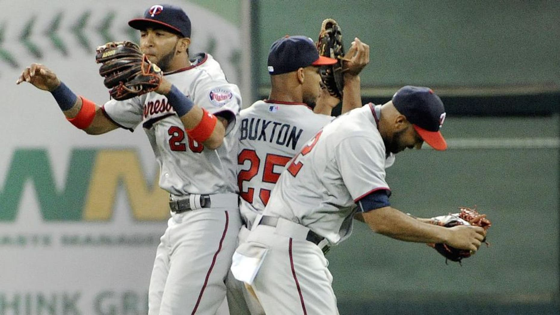 HOUSTON, TX - SEPTEMBER 5: (L TO R) Eddie Rosario, Byron Buxton, and Miguel Sano celebrate the Minnesota Twins' 3-2 victory over the Houston Astros at Minute Maid Park on September 5, 2015 in Houston, Texas. (Photo by Eric Christian Smith/Getty Images)