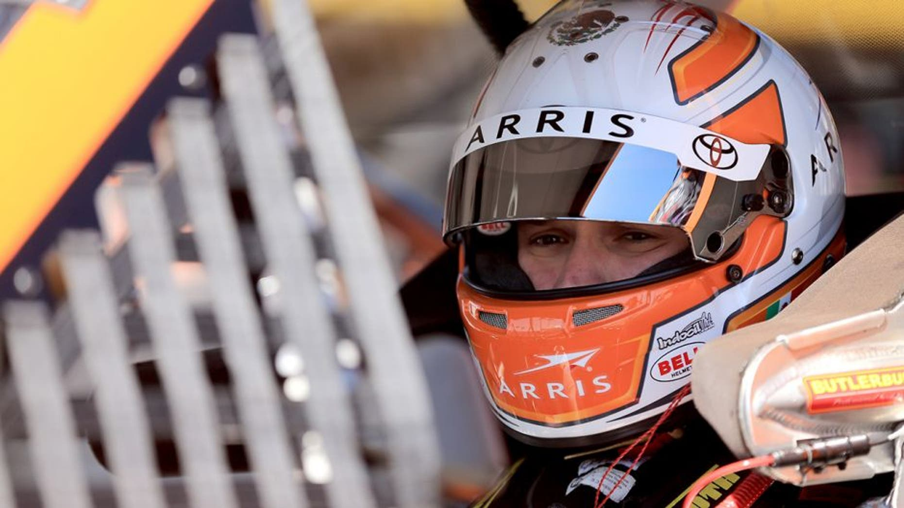 DAYTONA BEACH, FL - FEBRUARY 18: Daniel Suarez, driver of the #51 ARRIS Toyota, sits in his truck during practice for the NASCAR Camping World Truck Series NextEra Energy Resources 250 at Daytona International Speedway on February 18, 2016 in Daytona Beach, Florida. (Photo by Mike Ehrmann/Getty Images)