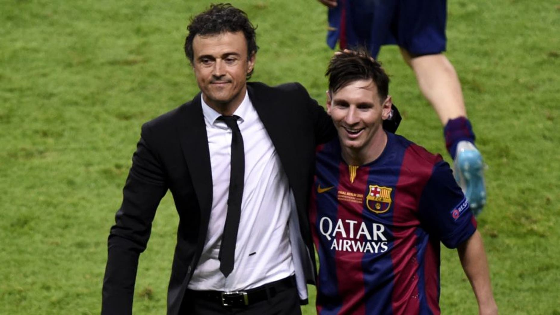 Barcelona's coach Luis Enrique and Barcelona's Argentinian forward Lionel Messi (R) celebrate after winning the UEFA Champions League Final football match between Juventus and FC Barcelona at the Olympic Stadium in Berlin on June 6, 2015. AFP PHOTO / ODD ANDERSEN (Photo credit should read ODD ANDERSEN/AFP/Getty Images)