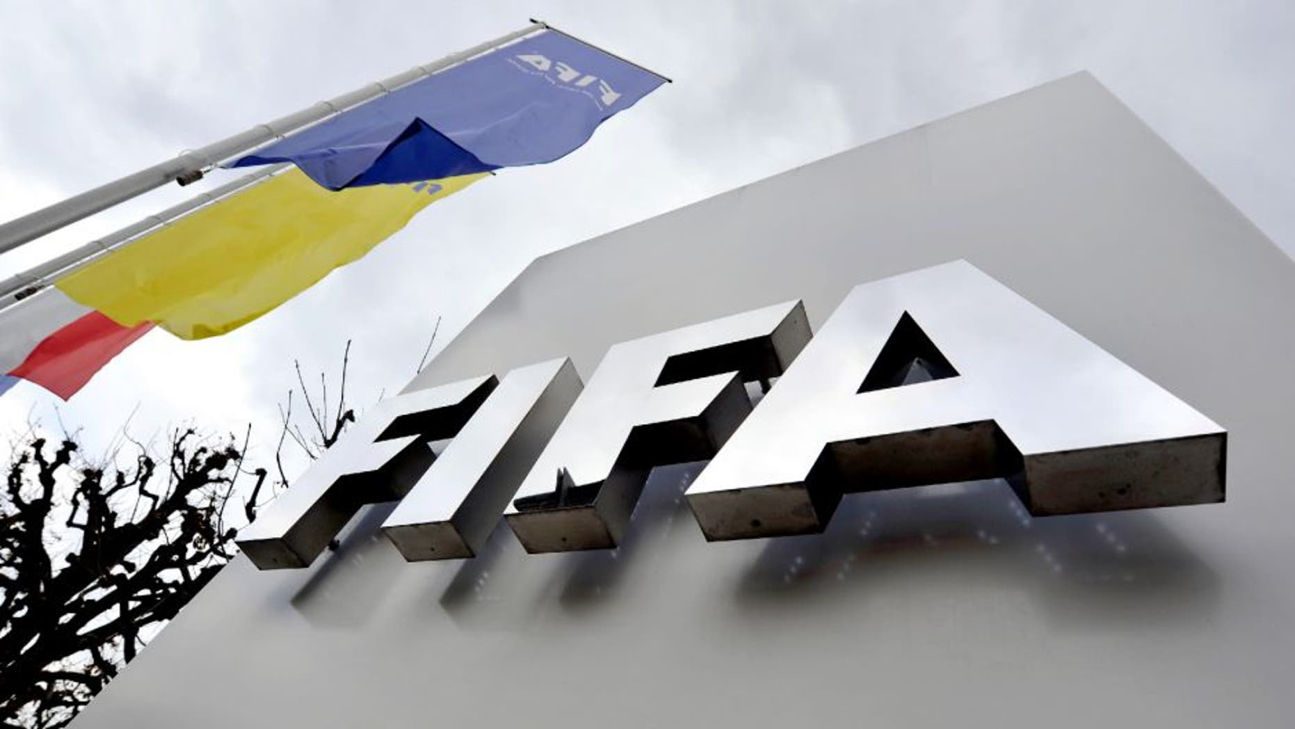 ZURICH, SWITZERLAND - OCTOBER 09: A FIFA logo next to the entrance at the FIFA headquarters on October 9, 2015 in Zurich, Switzerland. On Thursday, FIFA's Ethics Committee provisionally banned FIFA President Joseph S. Blatter from all football activities for the duration of 90 days. (Photo by Harold Cunningham/Getty Images)