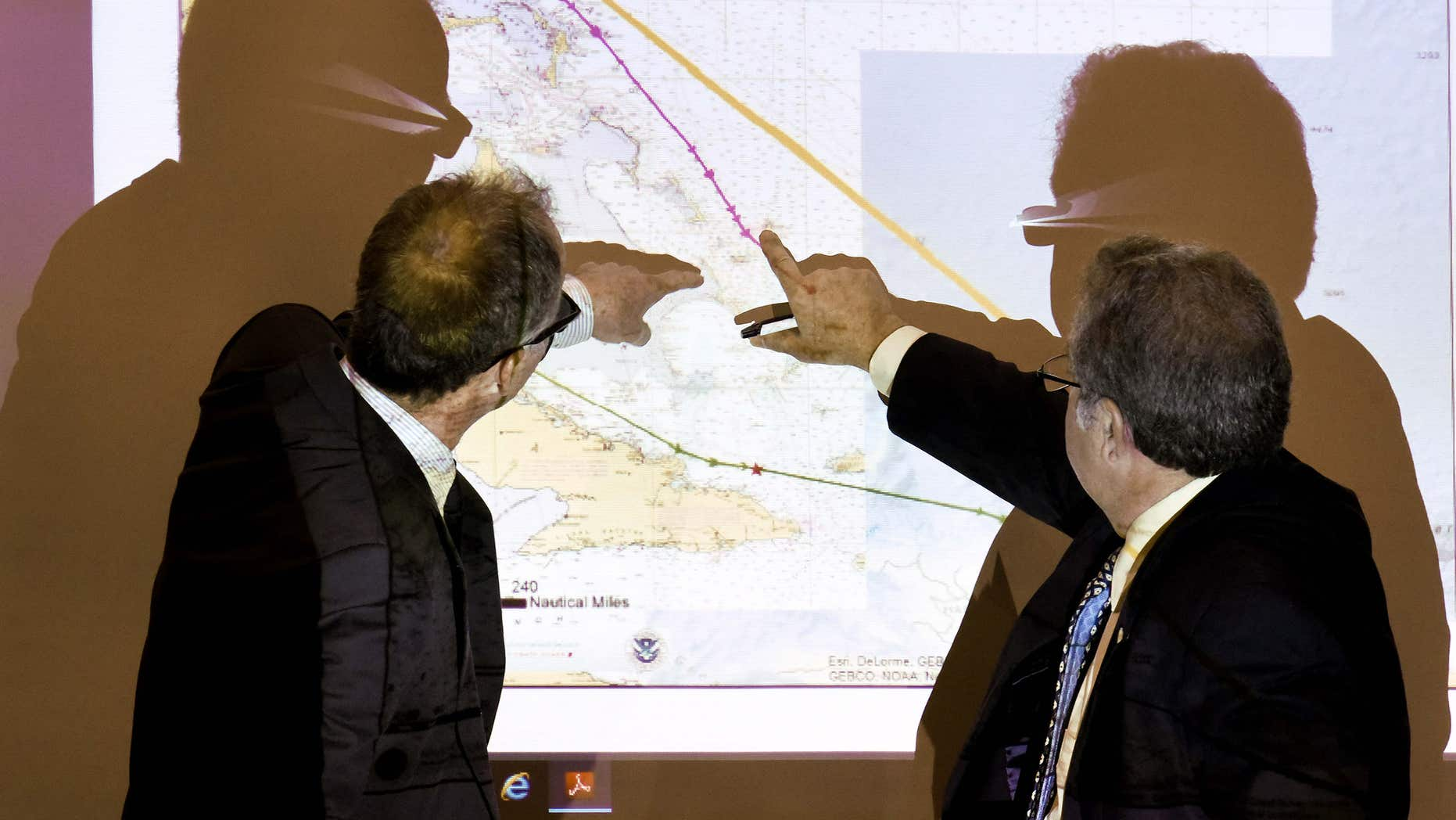 Baird, former second mate of the El Faro, left, and Mike Kucharski with the National Transportation Safety Board discuss route options available to the El Faro when dealing with the approaching hurricane during a hearing investigating the ship's sinking last October, Thursday, Feb. 18, 2016, in Jacksonville, Fla.