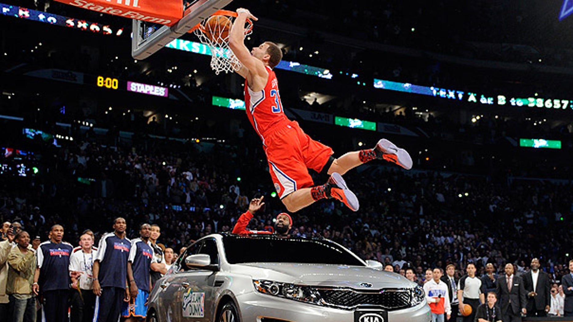 Feb. 19: Los Angeles Clippers' Blake Griffin dunks over a car as teammate Baron Davis looks on from inside the car during the Slam Dunk Contest in Los Angeles.