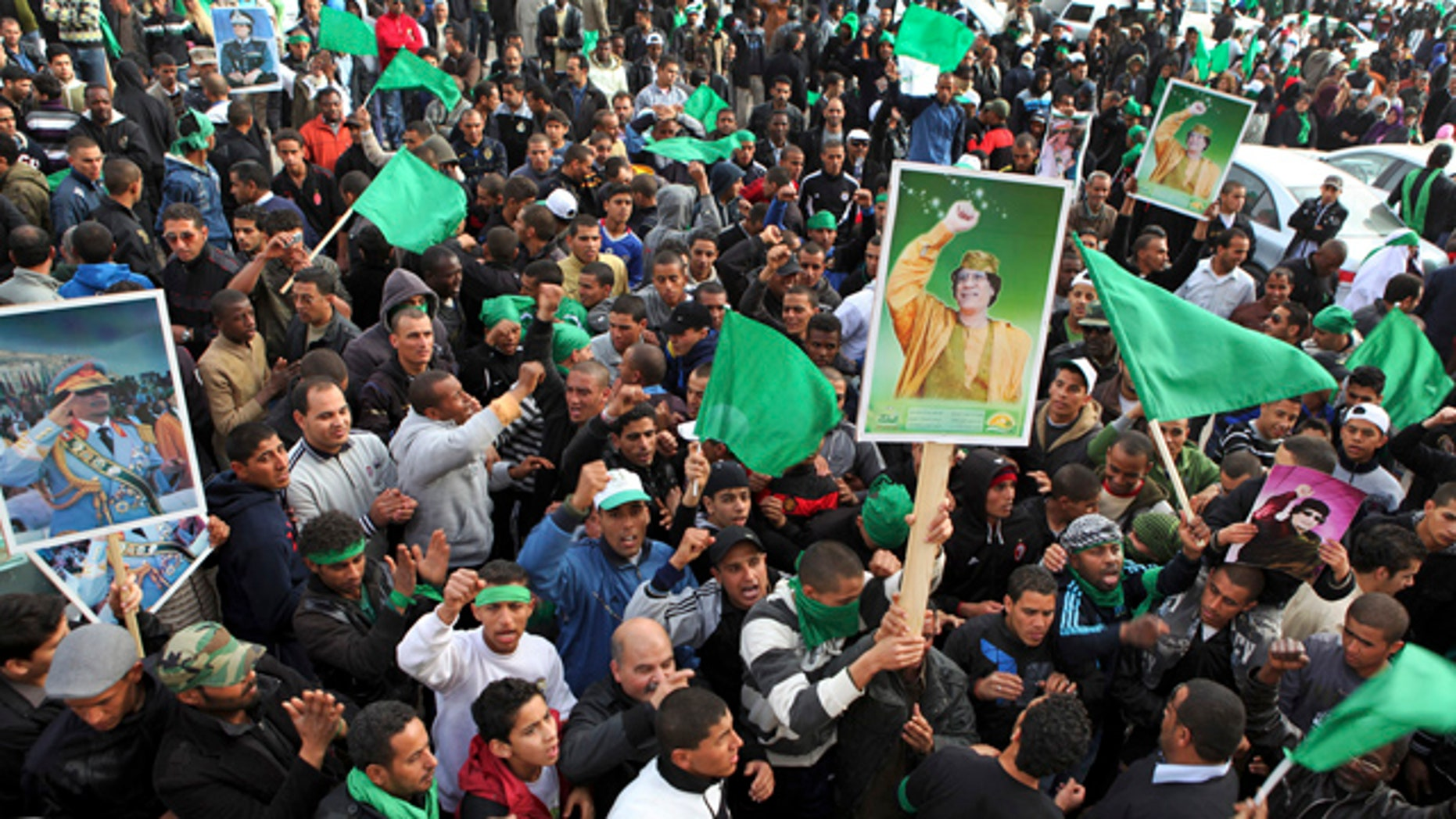 Feb. 18: Pro-Gadhafi supporters gather in Green Square after traditional Friday prayers in Tripoli, Libya.