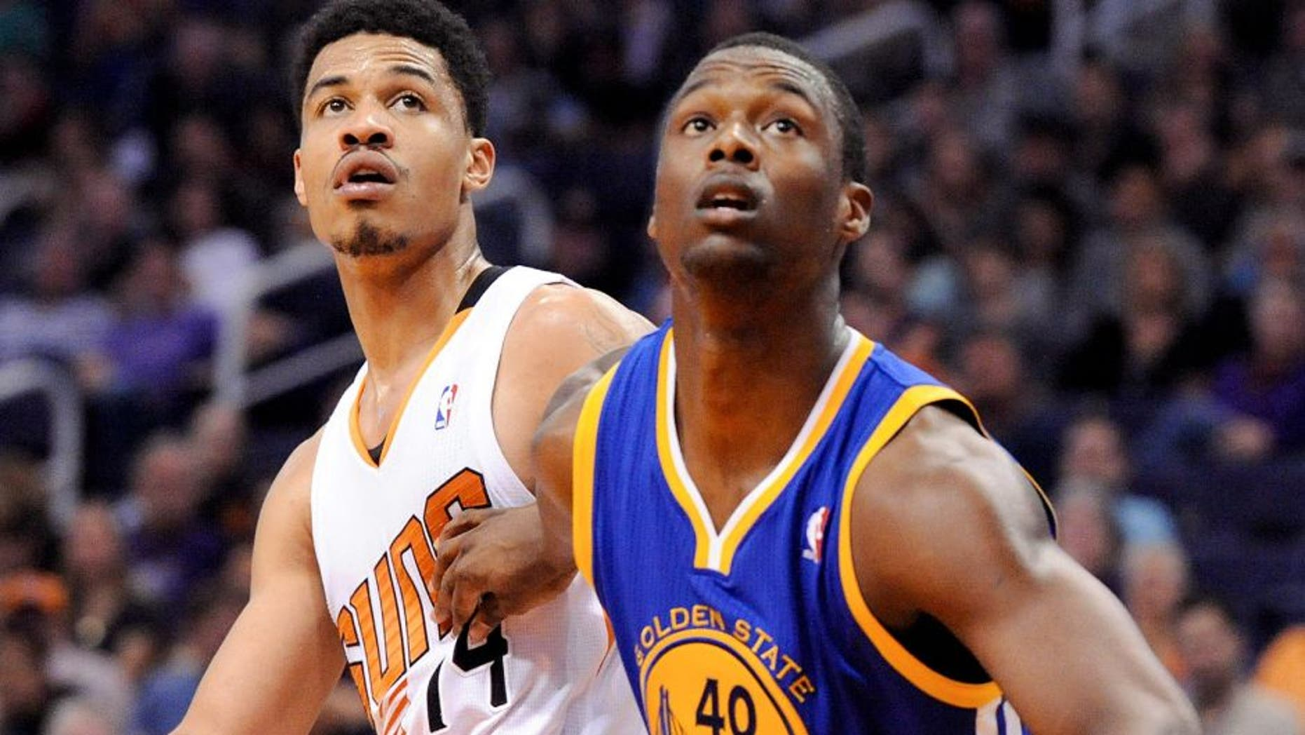 Feb 8, 2014; Phoenix, AZ, USA; Phoenix Suns guard Gerald Green (14) and Golden State Warriors forward Harrison Barnes (40) battle for positioning during the third quarter at US Airways Center. The Suns won 122-109. Mandatory Credit: Casey Sapio-USA TODAY Sports
