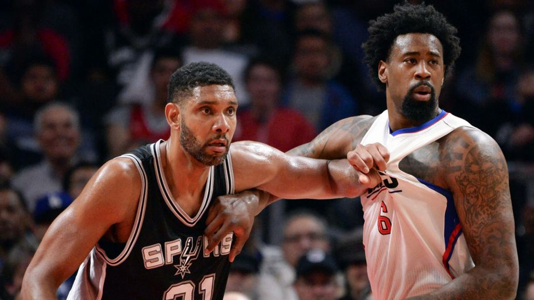 Feb 18, 2016; Los Angeles, CA, USA; San Antonio Spurs center Tim Duncan (21) and Los Angeles Clippers center DeAndre Jordan (6) jostle for position on the baseline during the 2nd half at Staples Center. Mandatory Credit: Robert Hanashiro-USA TODAY Sports