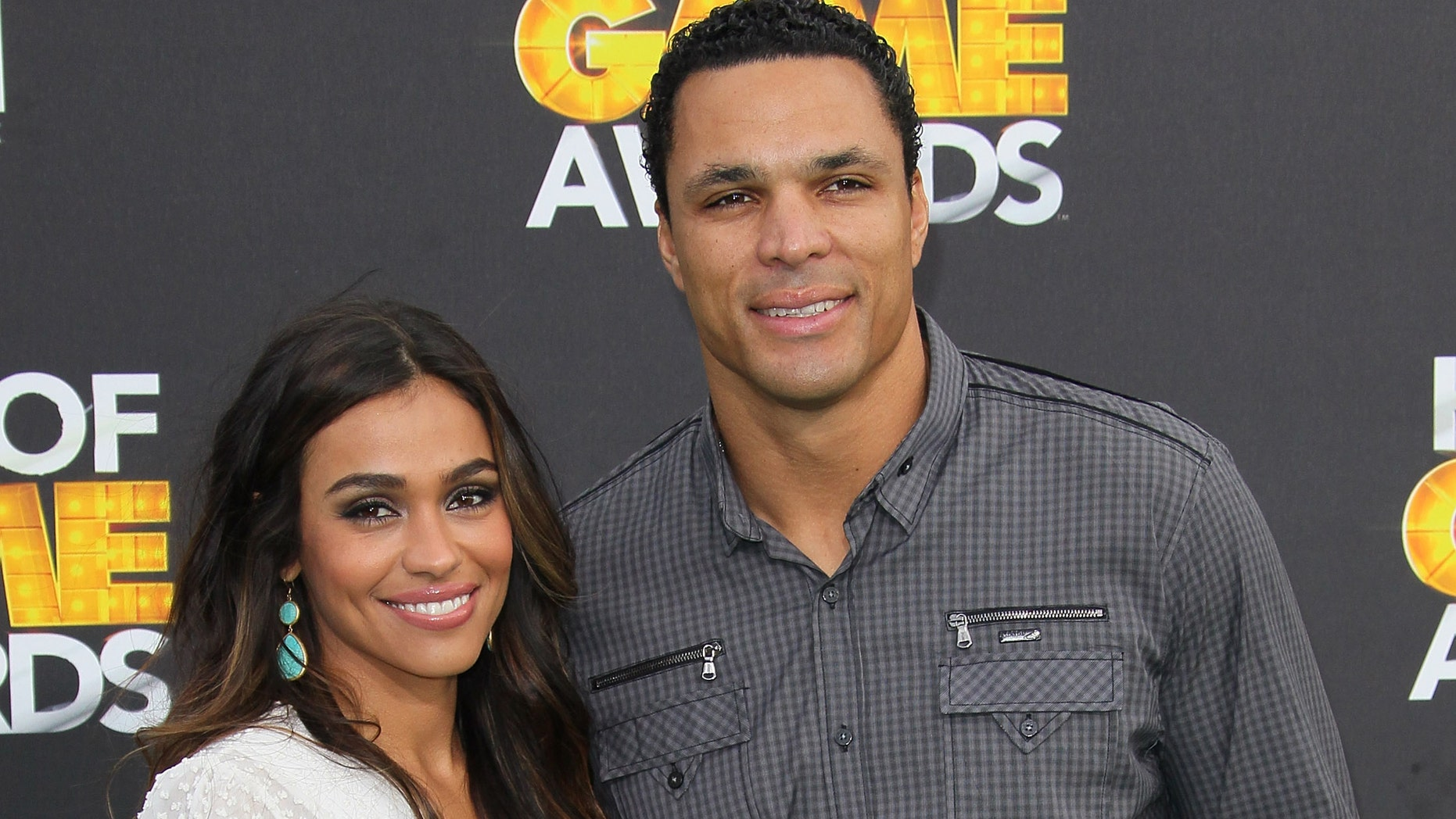 SANTA MONICA, CA - FEBRUARY 18:  NFL player Tony Gonzalez (R) and wife October Gonzalez attend the 2nd Annual Cartoon Network Hall of Game Awards at Barker Hangar on February 18, 2012 in Santa Monica, California.  (Photo by David Livingston/Getty Images)