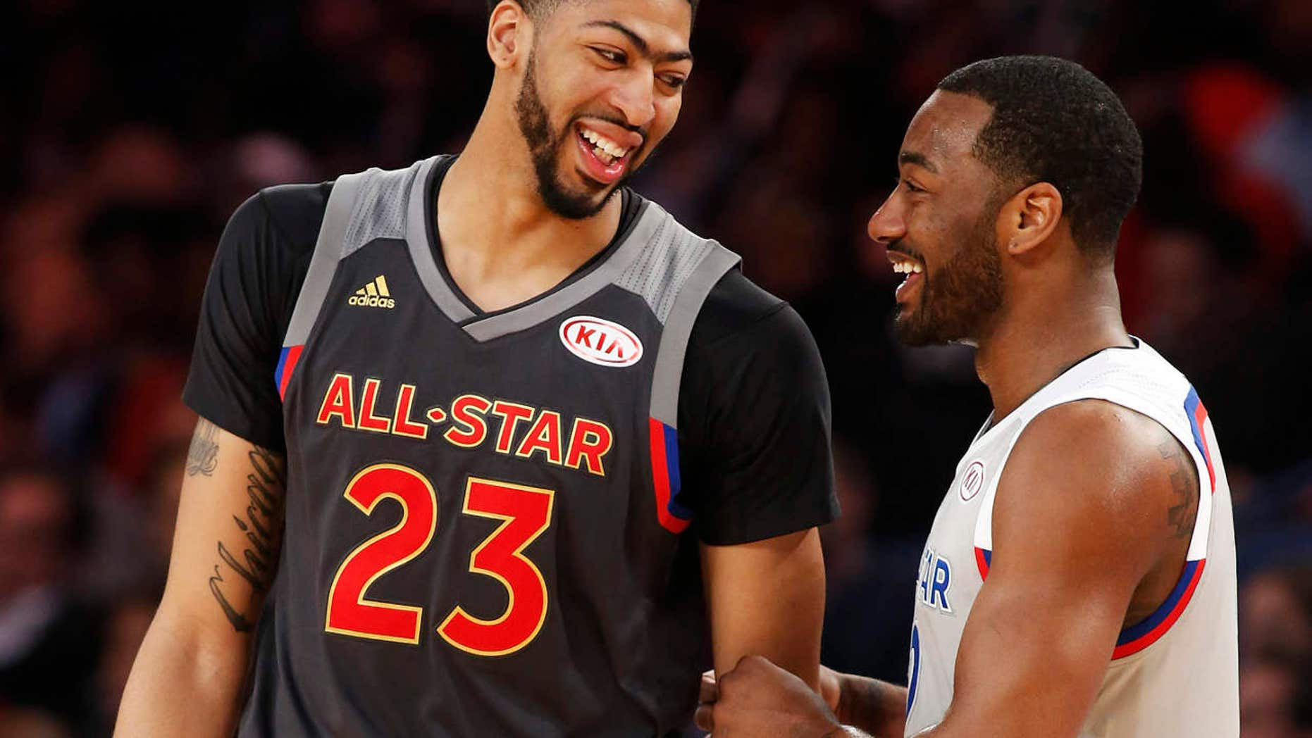 Western Conference forward Anthony Davis of the New Orleans Pelicans (23) laughs with Eastern Conference guard John Wall of the Washington Wizards (2) in the second half of the NBA All-Star basketball game in New Orleans, Sunday, Feb. 19, 2017.