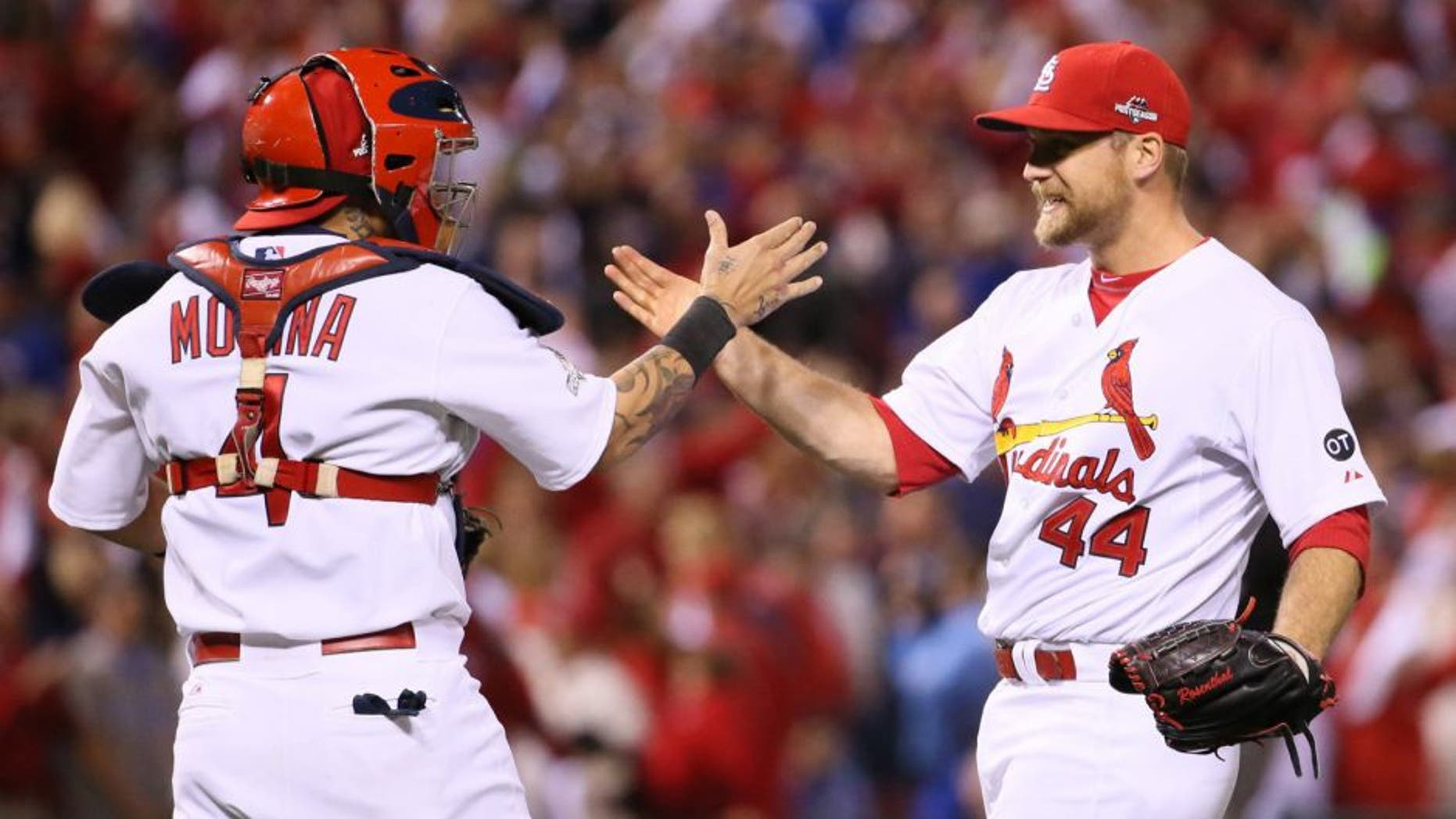 St. Louis Cardinals closer Trevor Rosenthal, right, celebrates with catcher Yadier Molina after preserving the shutout victory in the ninth inning against the Chicago Cubs in Game 1 of the NLDS on Friday, Oct. 9, 2015, at Busch Stadium in St. Louis. The Cards won, 4-0. (Chris Lee/St. Louis Post-Dispatch/TNS via Getty Images)