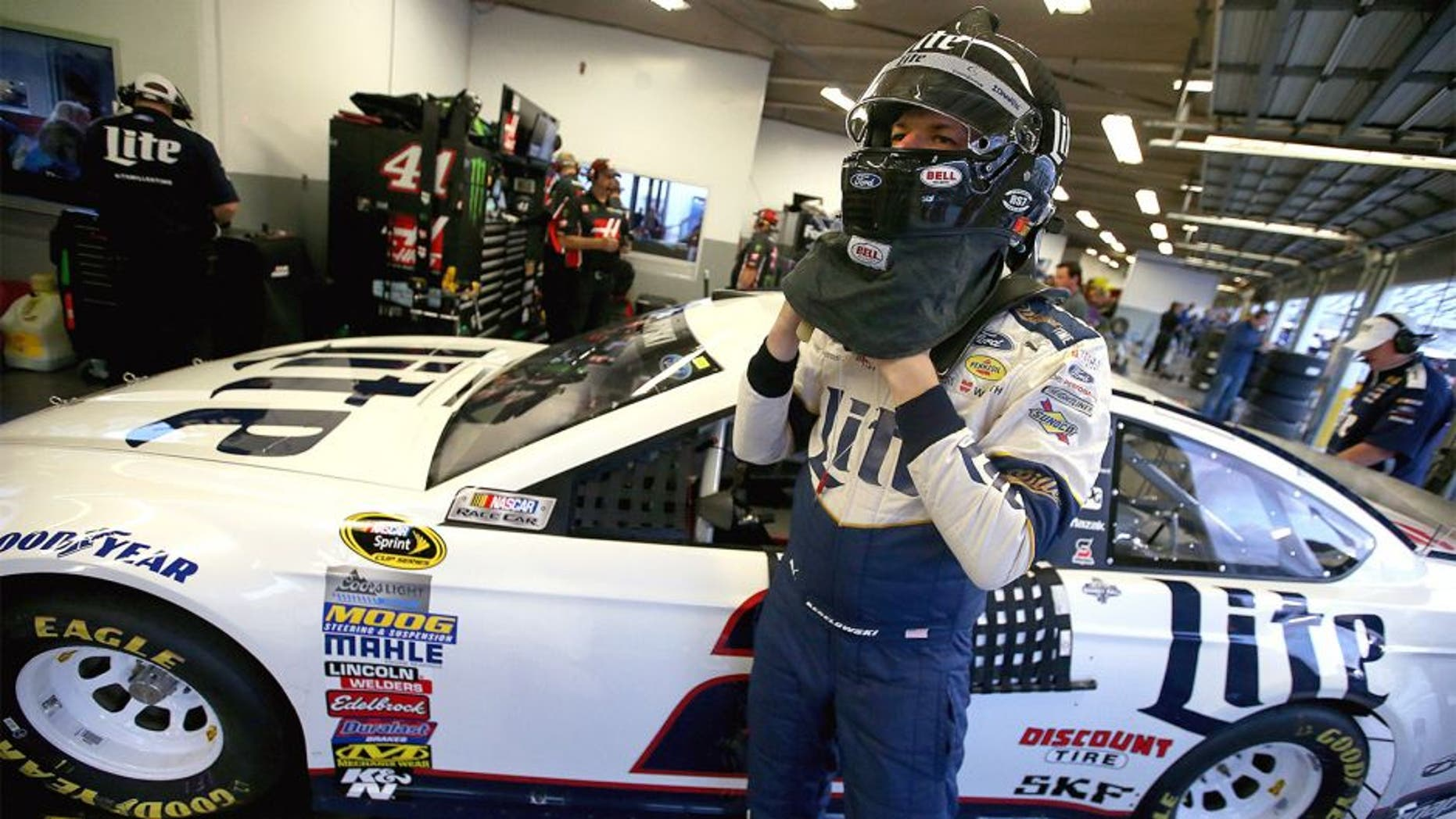 DAYTONA BEACH, FL - FEBRUARY 17: Brad Keselowski, driver of the #2 Miller Lite Ford, stands in the garage area during practice for the Daytona 500 at Daytona International Speedway on February 17, 2016 in Daytona Beach, Florida. (Photo by Sean Gardner/Getty Images)